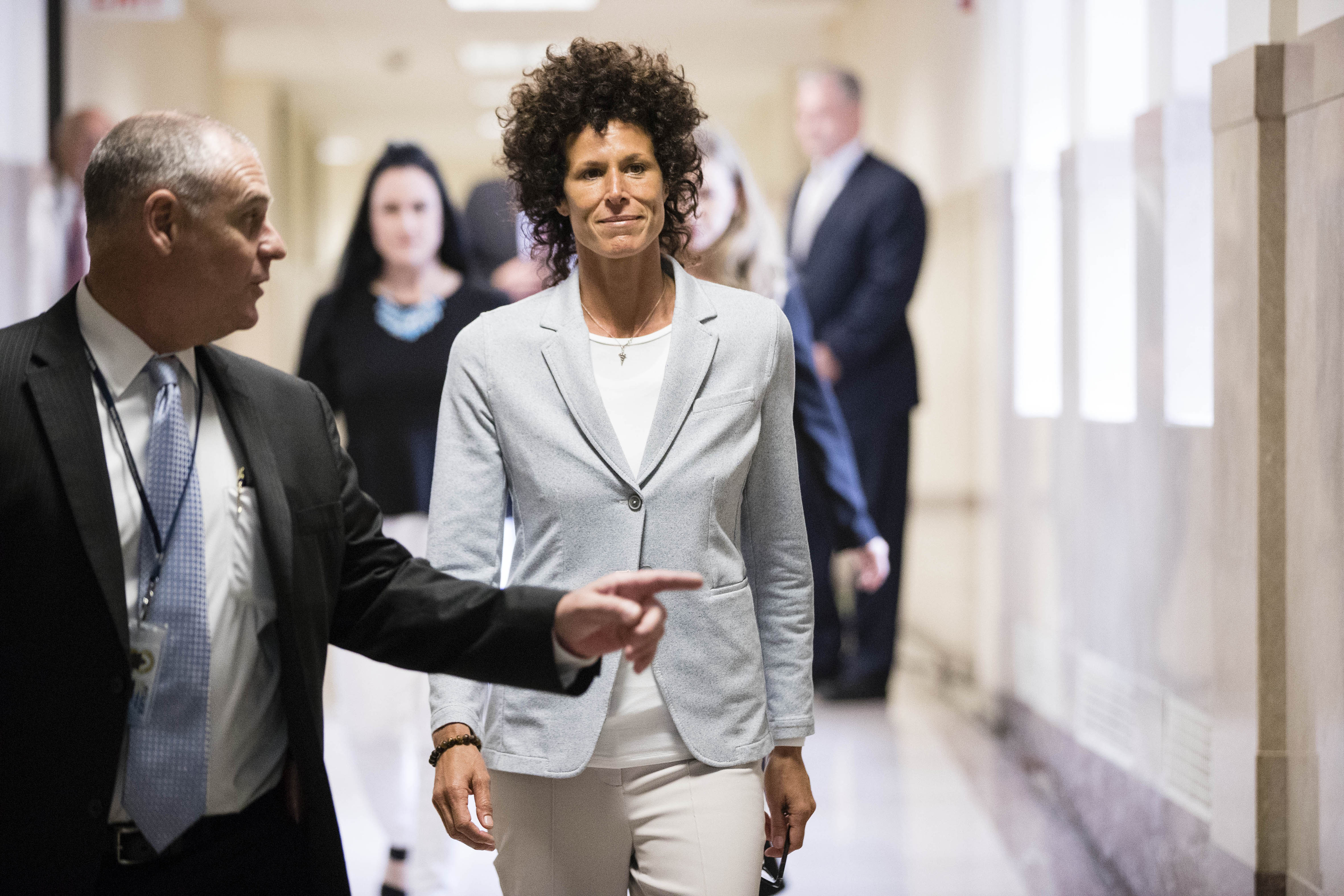 Andrea Constand, whom prosecutors say Bill Cosby sexually assaulted, walks to the courtroom during Cosby's trial at the Montgomery County Courthouse, in Norristown, Pennsylvania, June 6.