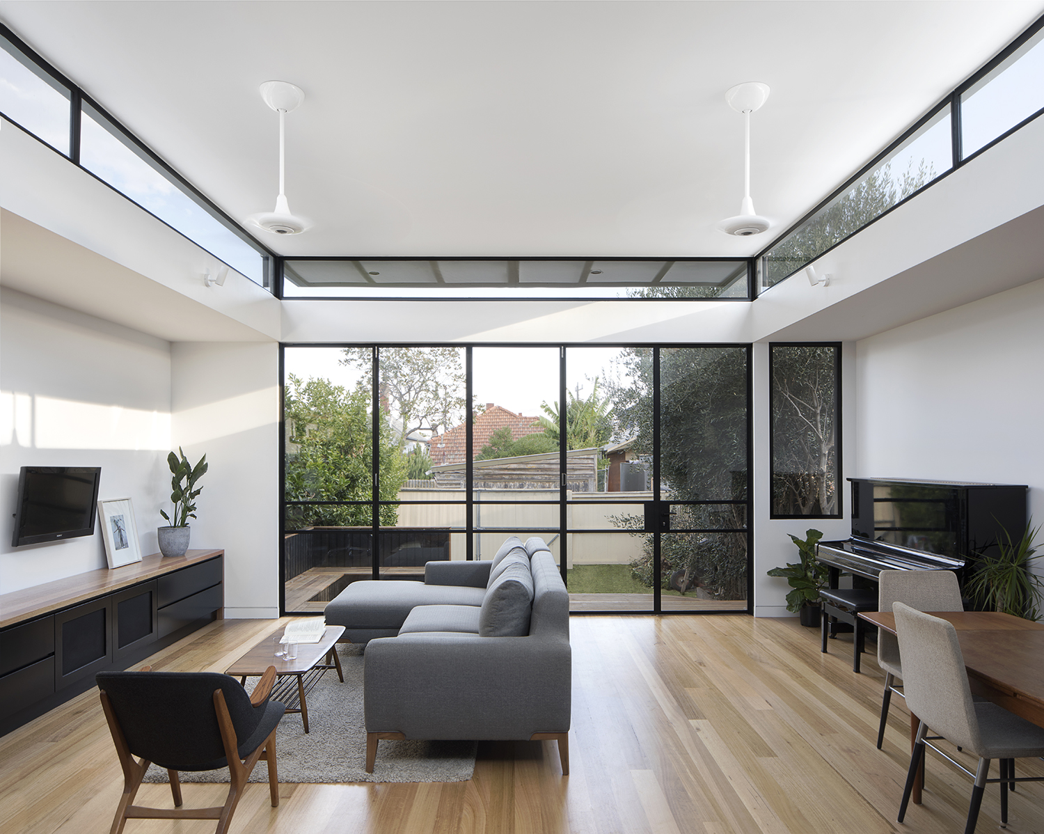 Home renovation adds a curving roof to let in light