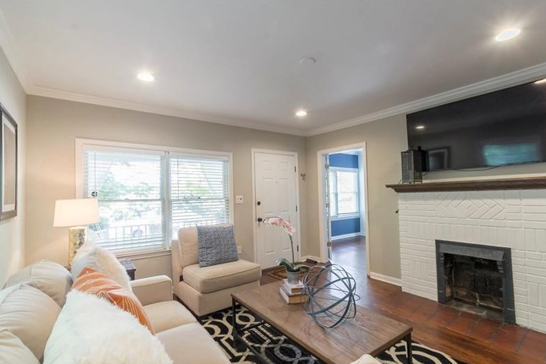 At the rear of the house, a screened-in porch extends the living space of  the home. The patio and fenced-in backyard provide an additional location  for ...