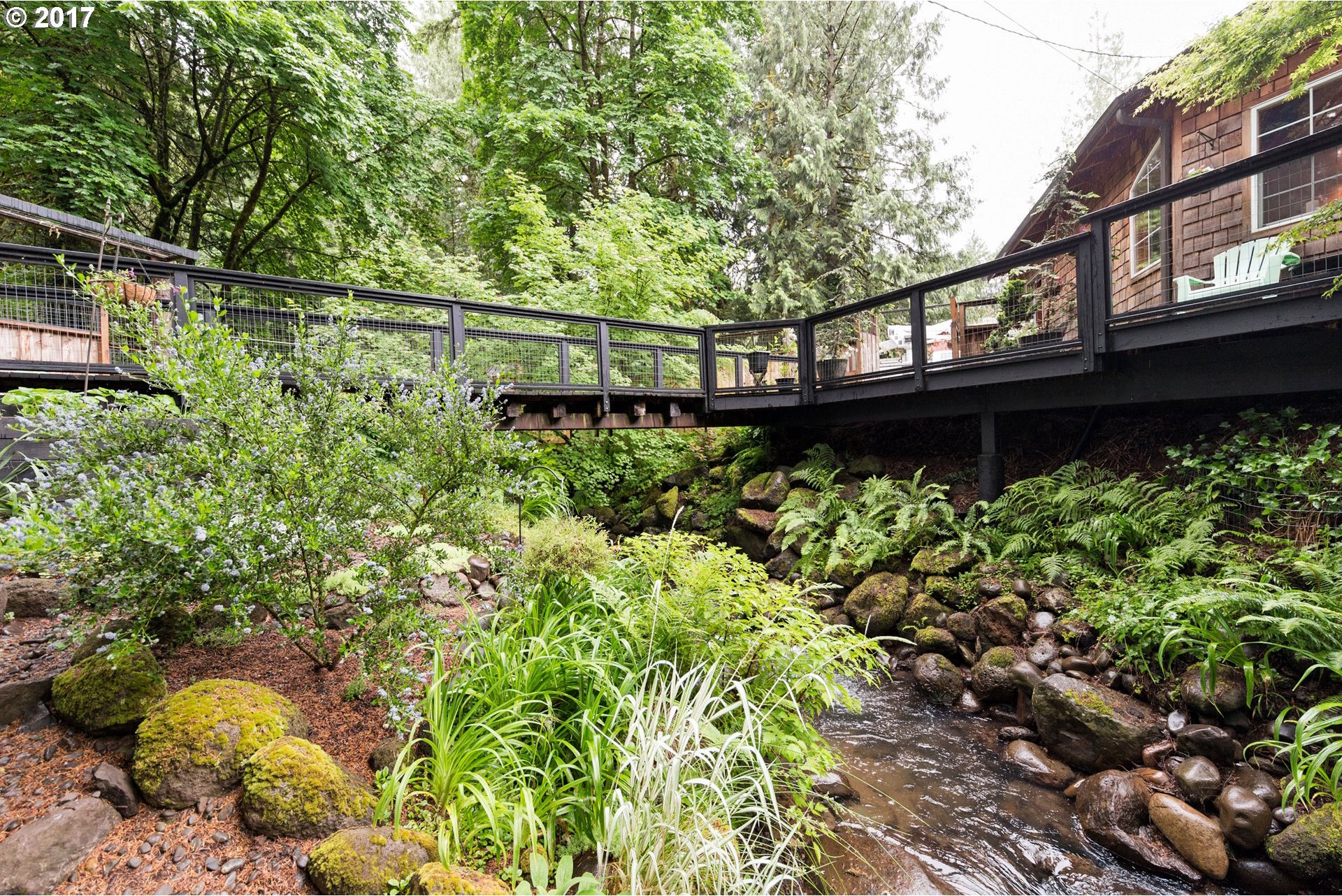 adorable cabin in the woods features creek for 225k curbed