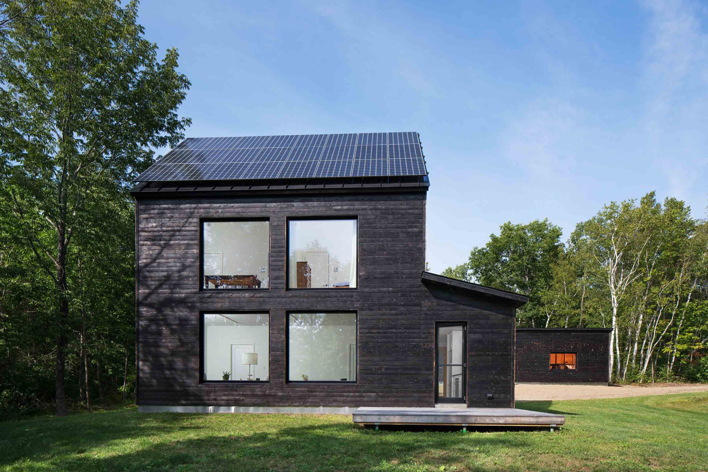 Prefab homes from go logic offer rural modernism for Modern new england home plans