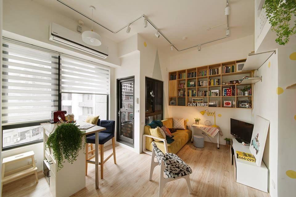 Built above the apartment's entrance, the loft structure helps create a  small entrance foyer with storage. Visitors then enter into the main living  room, ...
