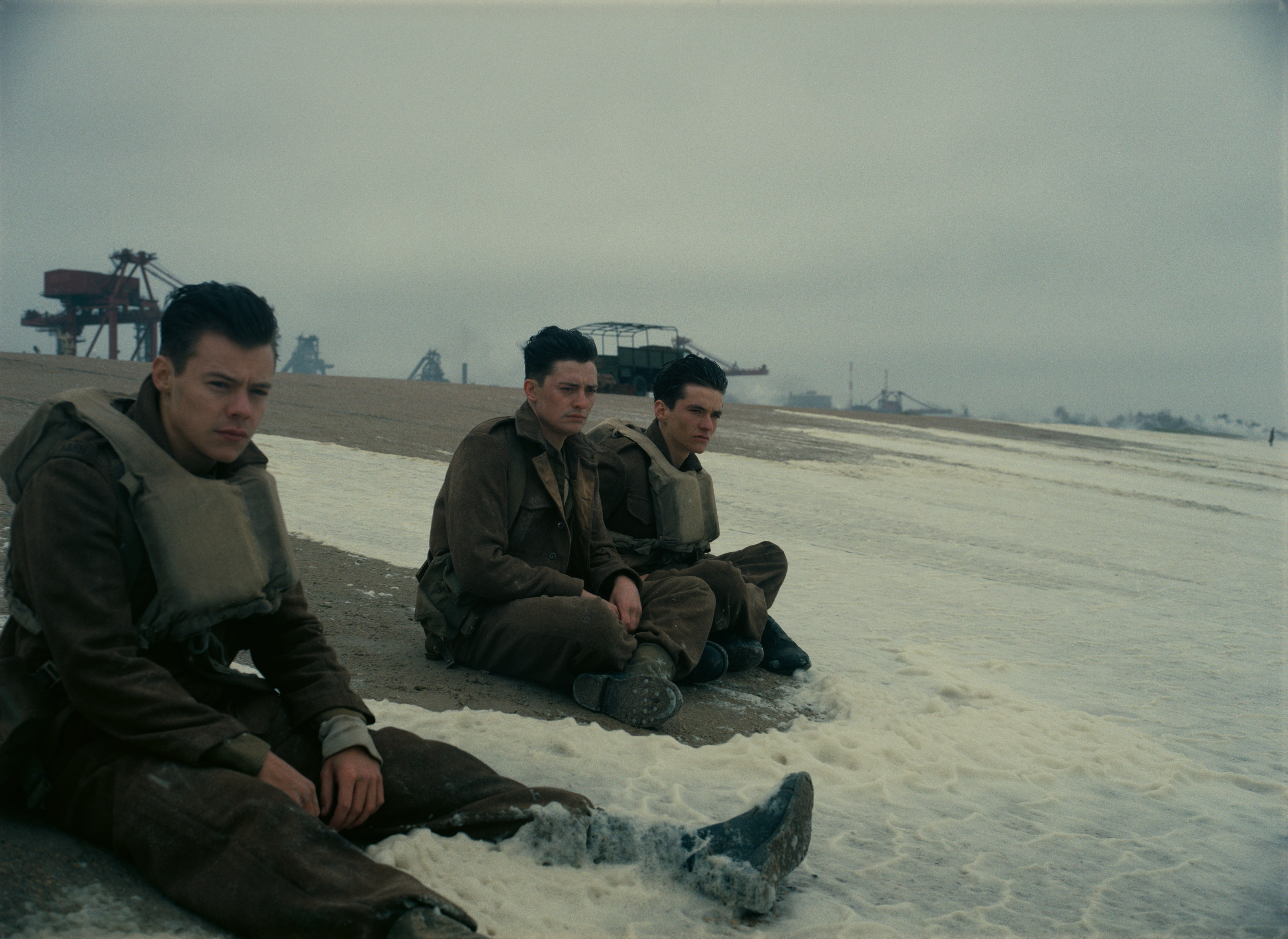 Dunkirk - soldiers sitting on the beach