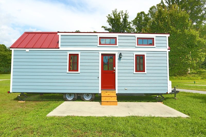 A Blue And Red Tiny Home.