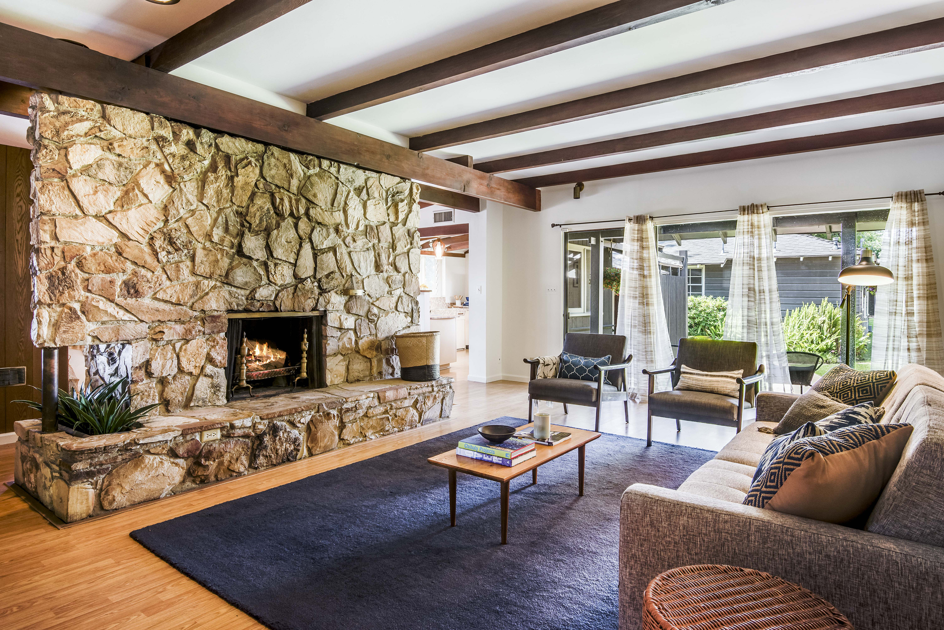 Outside the main three-bedroom house, there's an outdoor rock fireplace  underneath a breezeway that connects to the garage. The 600-square-foot  garage has ...