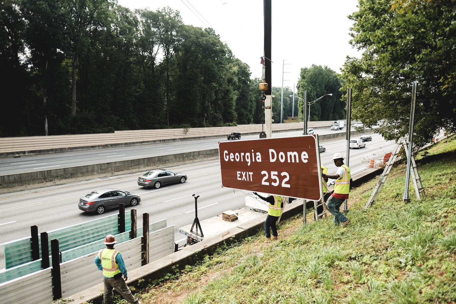 Georgia dome signs begin falling across atlanta for for Mercedes benz georgia dome
