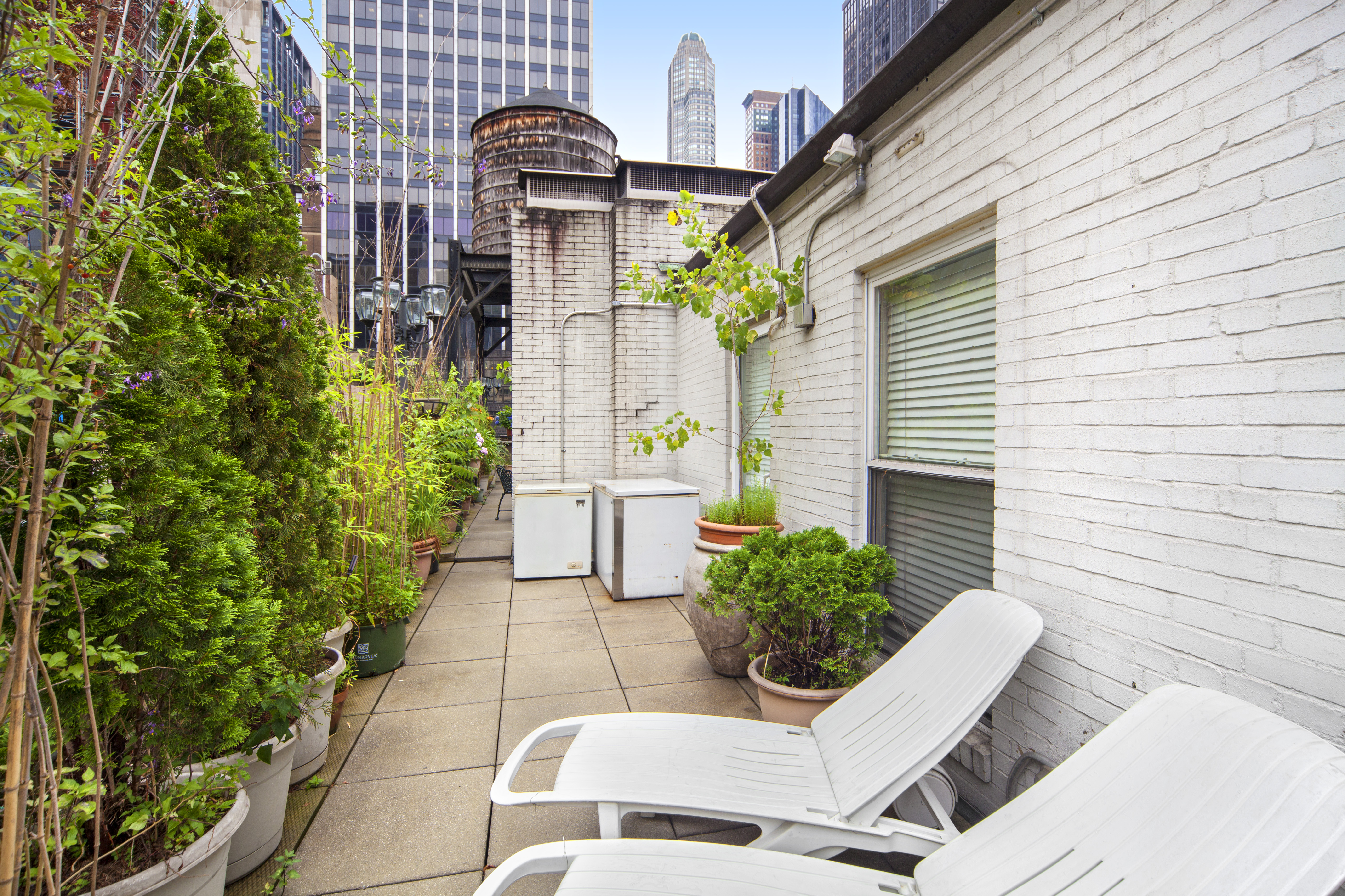 Quirky midtown penthouse with wraparound terrace seeks 2 for Use terrace in a sentence