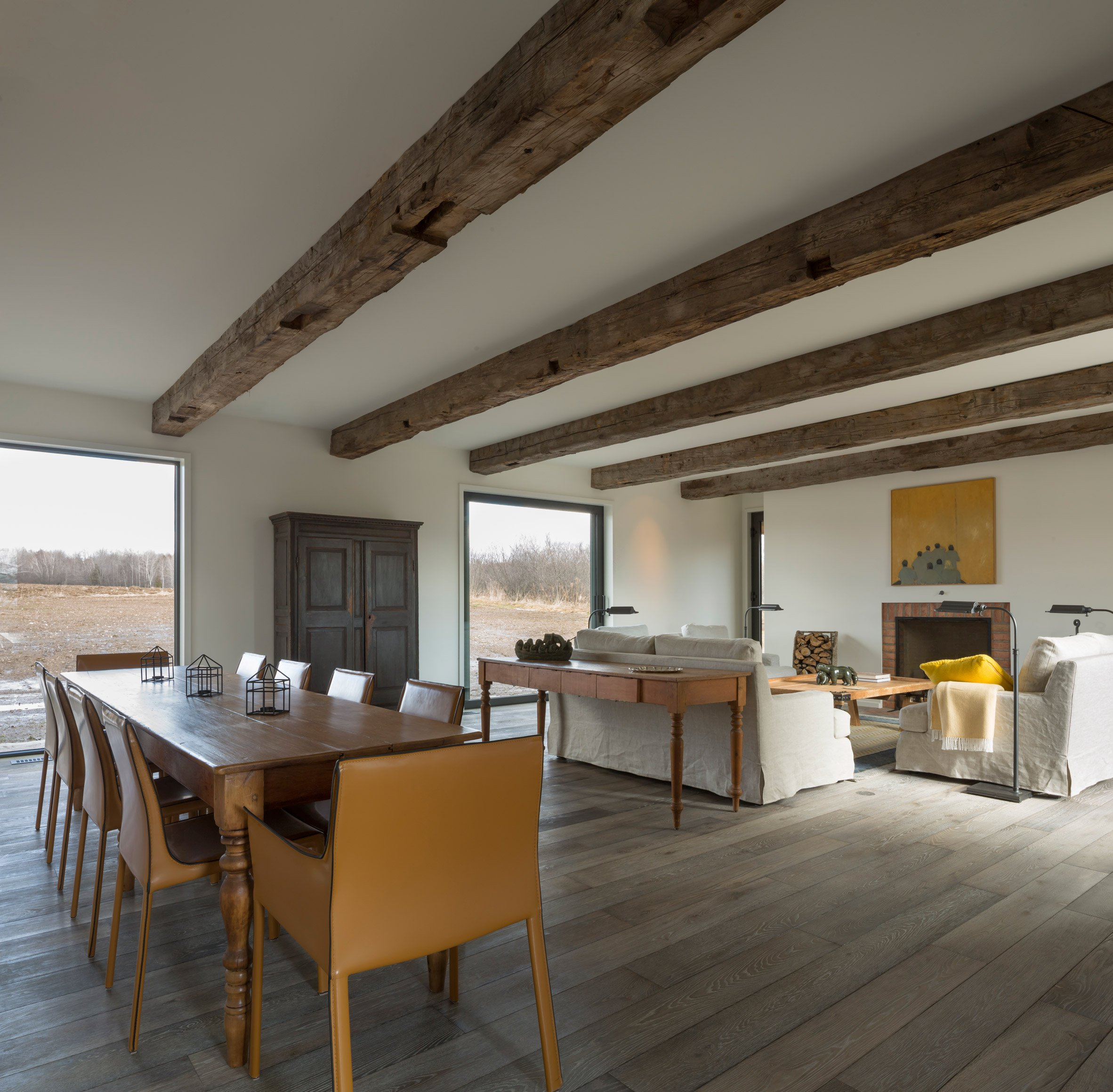 modern farmhouse updates the canadian homestead curbed where the exterior is clad in gray reclaimed wood from rundown barns in ontario the interiors are bright and modern with white walls vaulted ceilings or