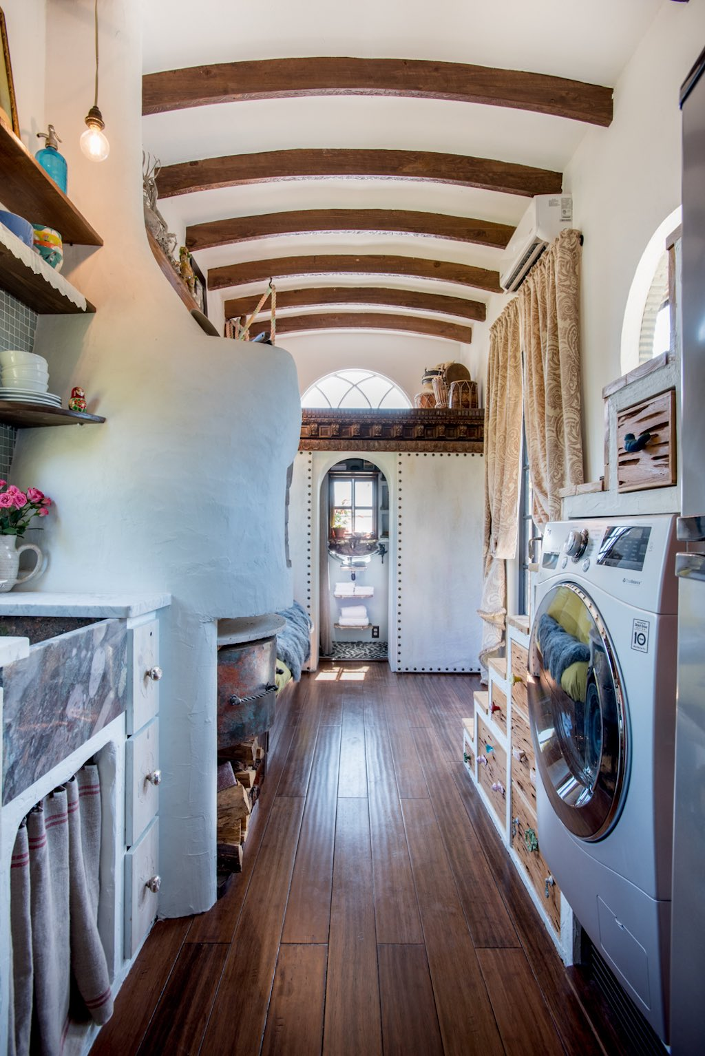 Dream tiny house comes with a pizza oven fireplace