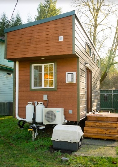 From The Outside, It Looks Like A Typical, Nicely Built Tiny House On Wheels.  A Few Things Make It Less Common: A Shed Roof Bumps Up The Ceiling Height  ...