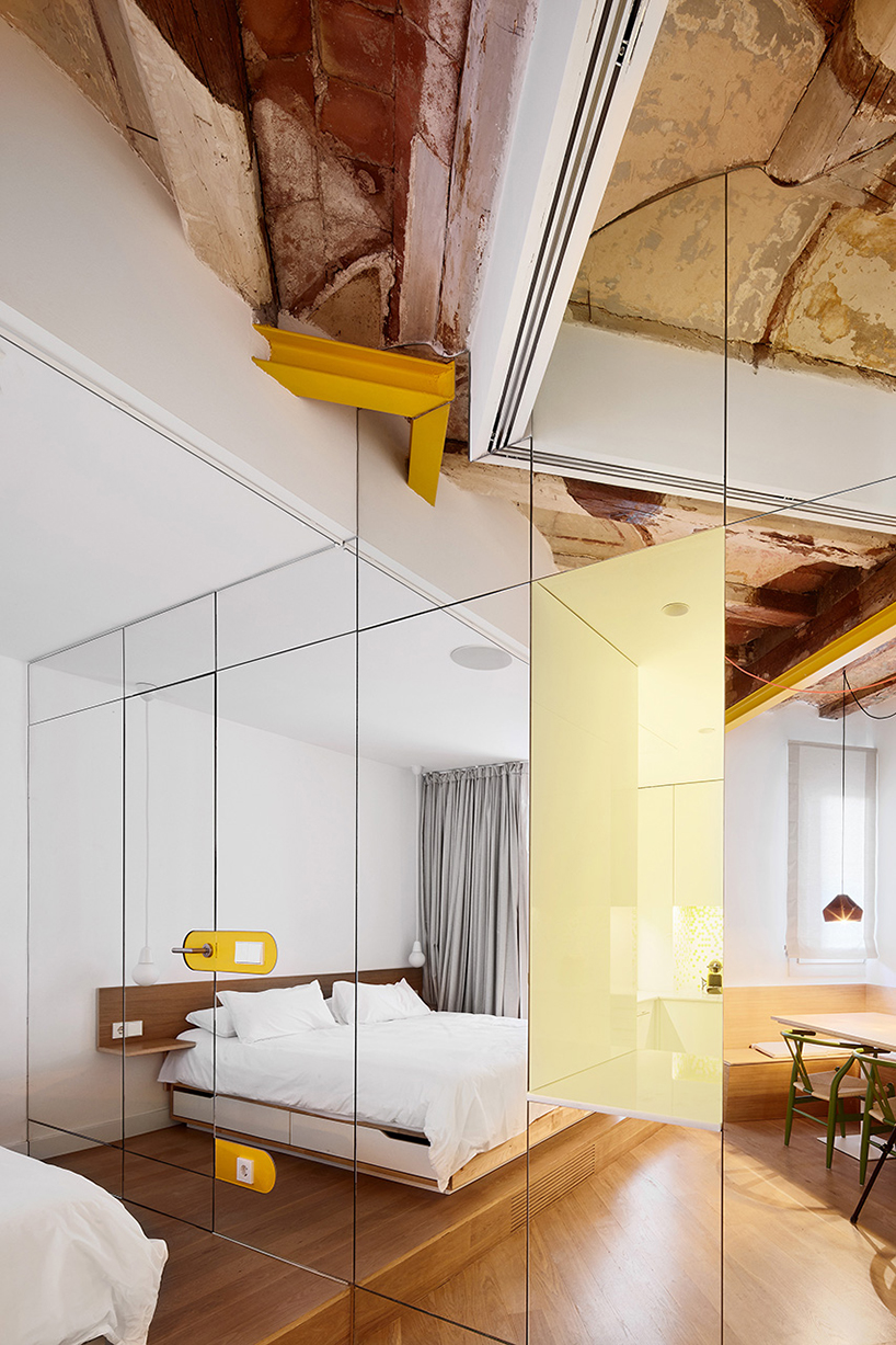 The Mirrors Form Face Of An Interior Cubic Volume Angled So That Its Walls Are Never Parallel With Apartment