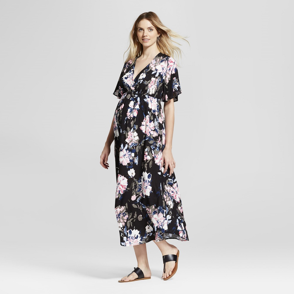 Targets new maternity clothes look nothing like maternity a pregnant woman in a floral dress ombrellifo Images