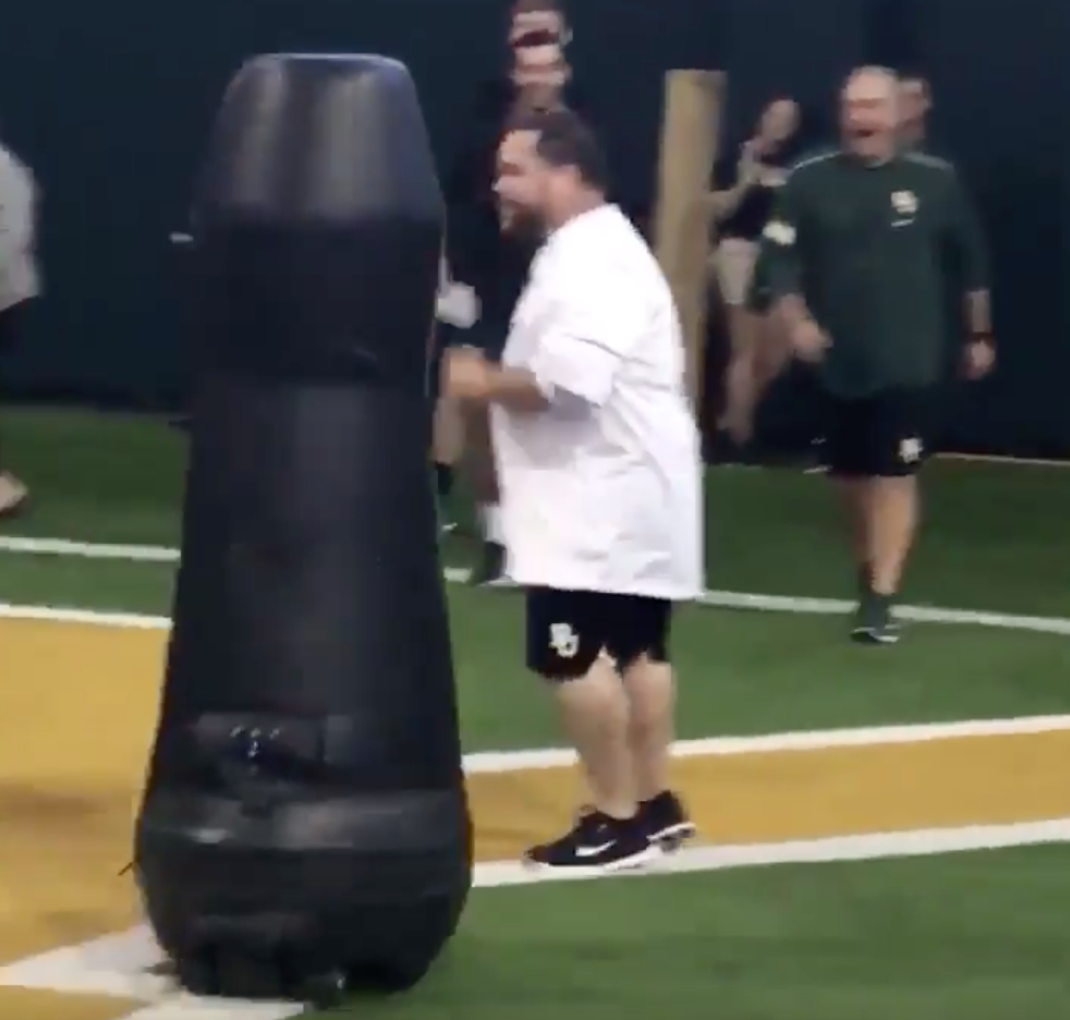 Baylor's Associate AD gets destroyed by tackling dummy after winning race