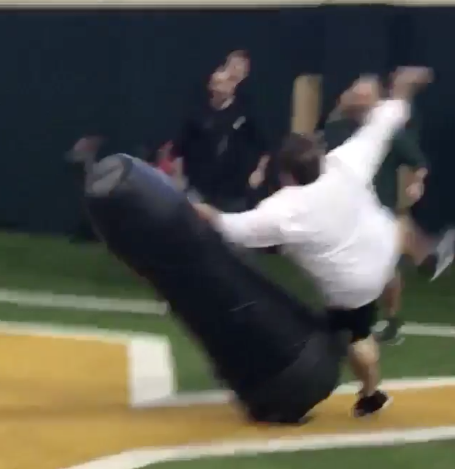 Baylor football administrator races tackle dummy, fails hilariously