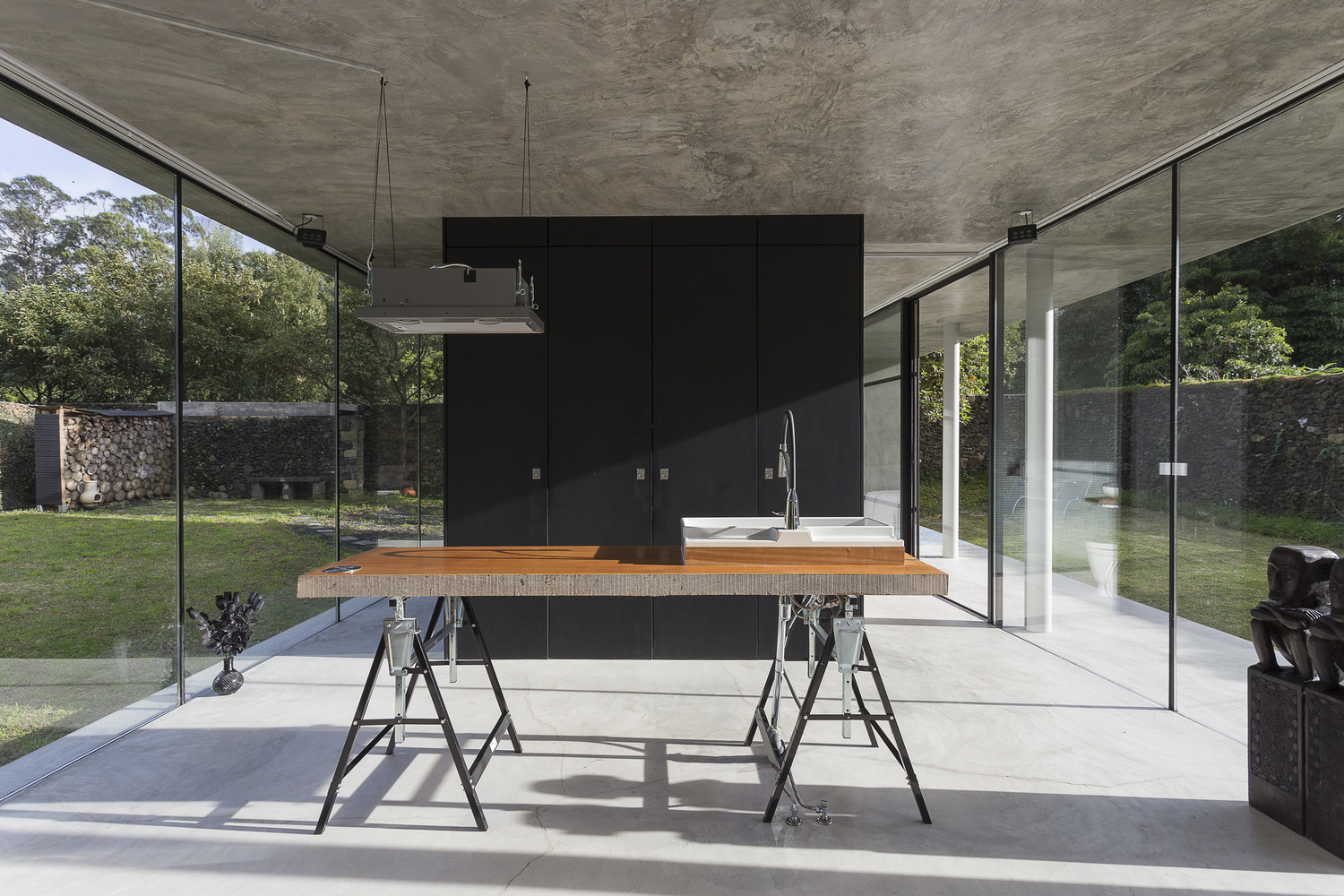 striking concrete and glass home has a twist curbed. Black Bedroom Furniture Sets. Home Design Ideas