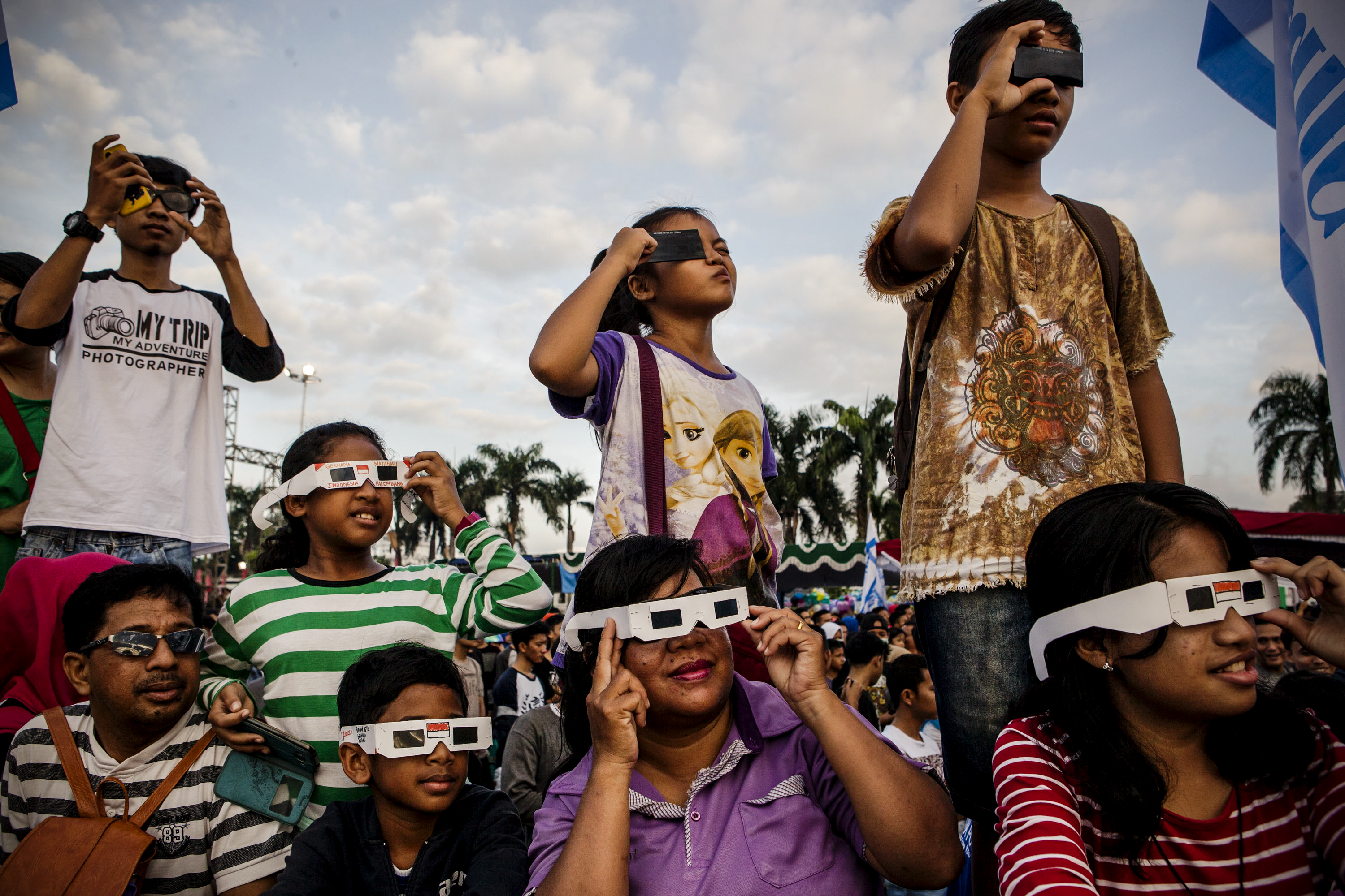 Image result for people looking through solar glasses