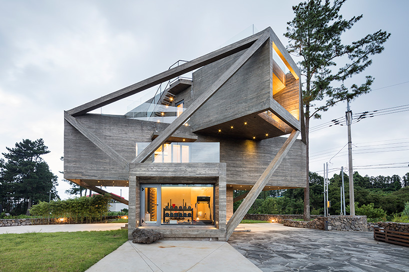 On the ground floor are a bedroom  playroom  laundry  and storage  facilities  while the second floor  accessed by a central staircase whose  walls include. This wacky concrete house is made of angled volumes   Curbed