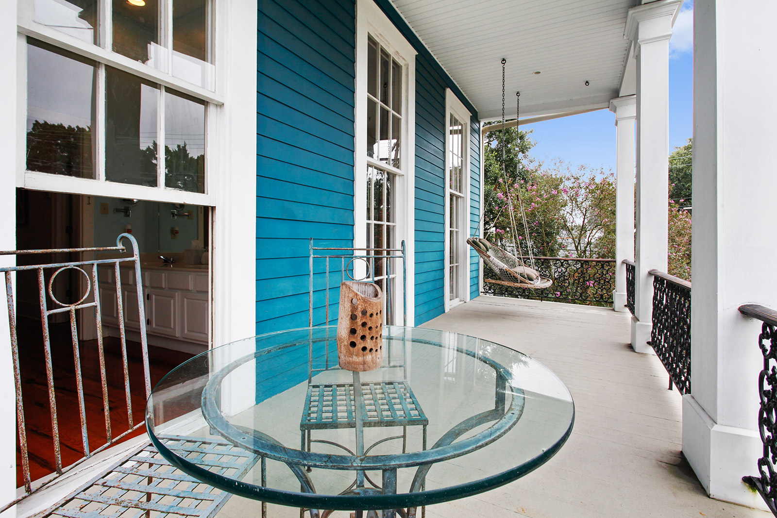 This lower garden district greek revival home just hit the for Balcony upstairs