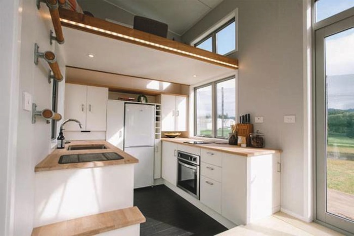 tiny house for millennials has a retractable staircase curbed. Black Bedroom Furniture Sets. Home Design Ideas