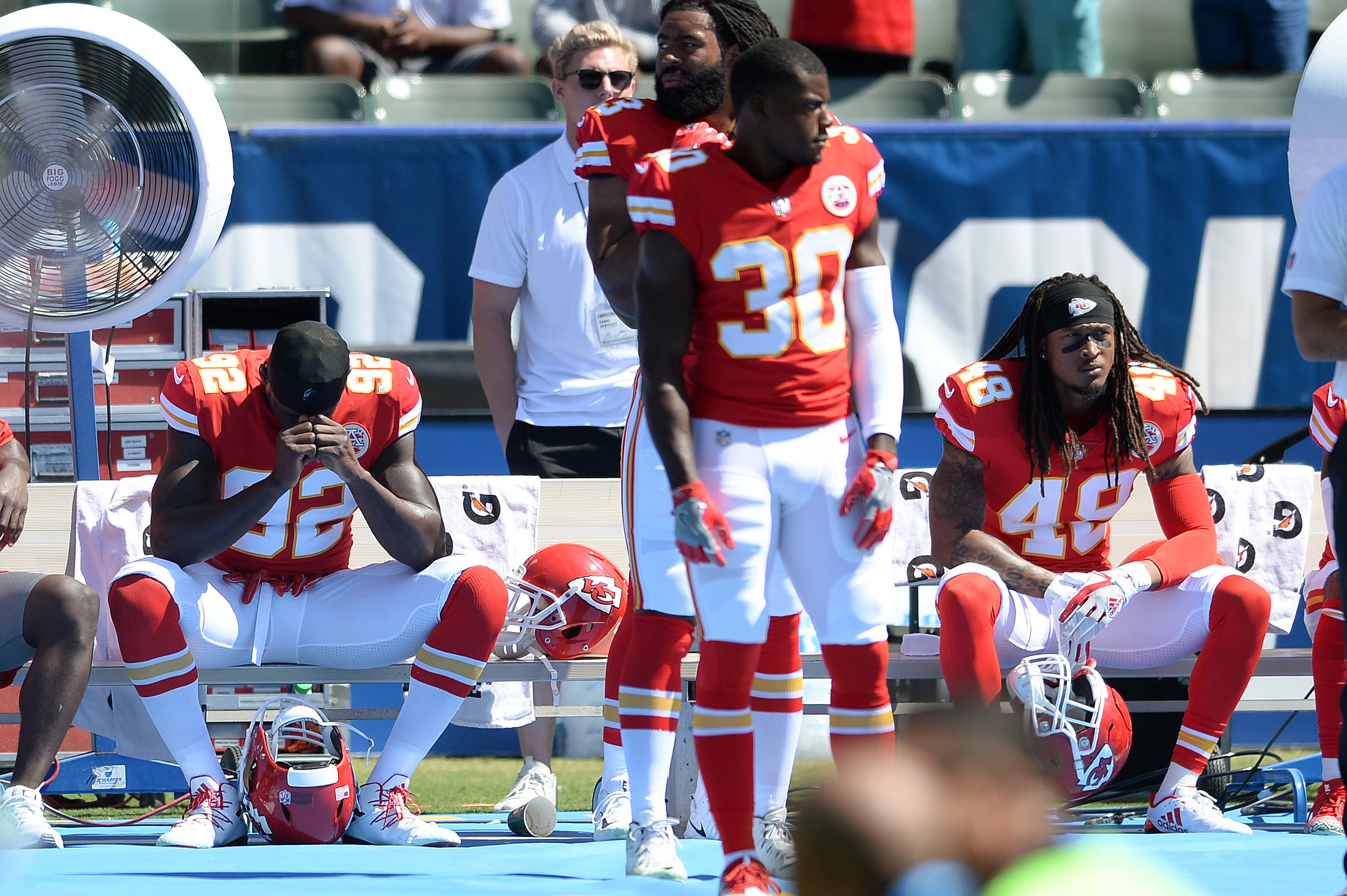 Chiefs Chris Conley kneels during the anthem Marcus Peters sits