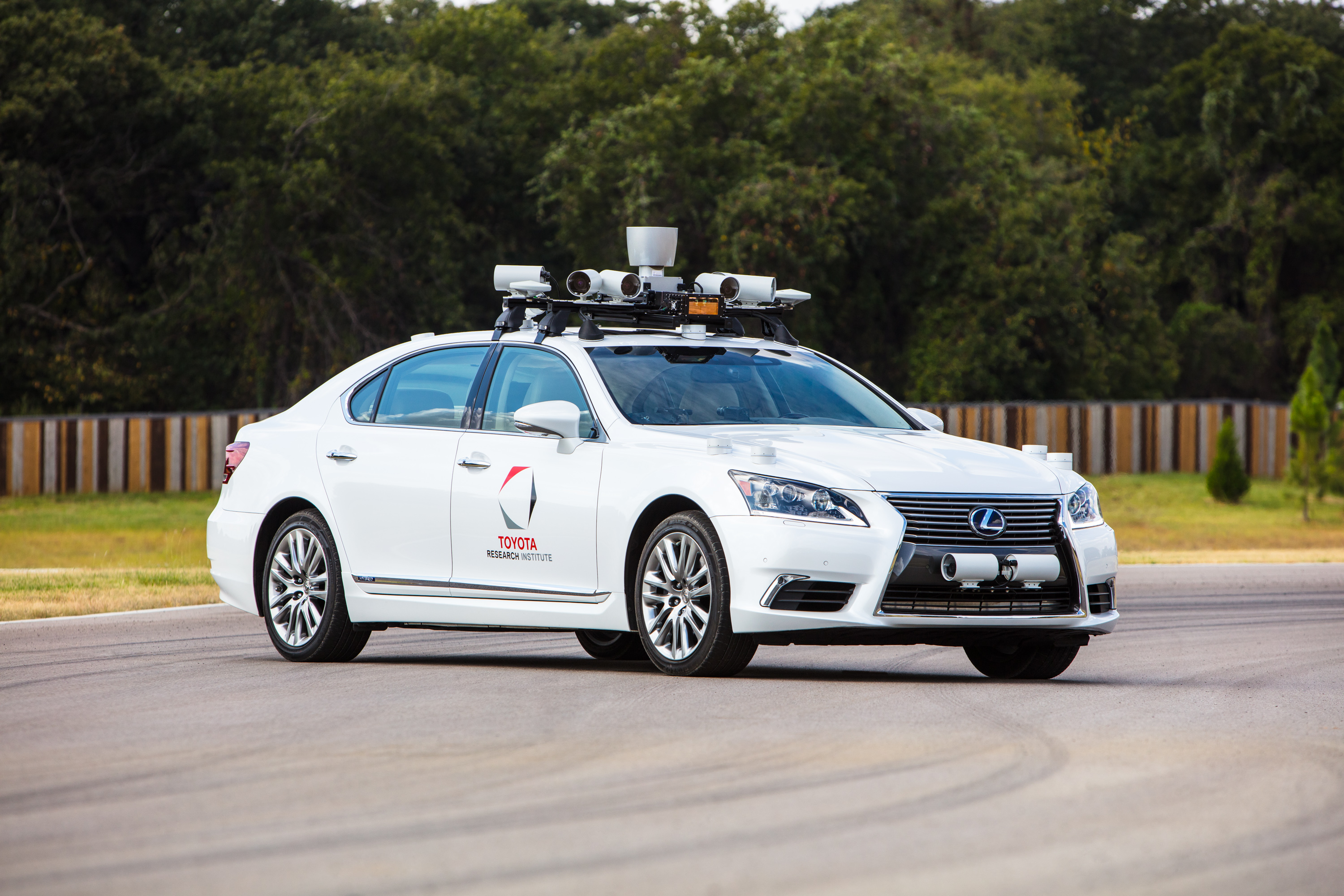 Toyota S New Self Driving Car Has Two Steering Wheels To