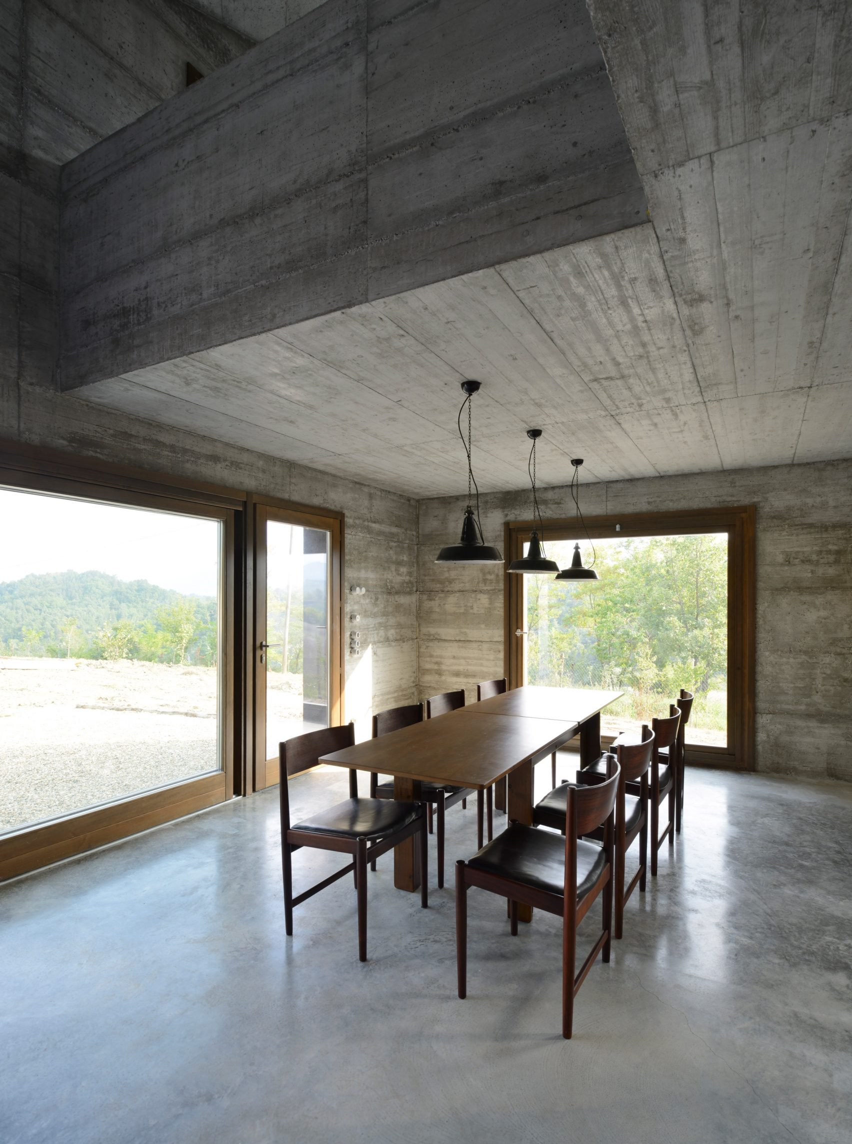 Cuboid concrete holiday home rises in northern Italy