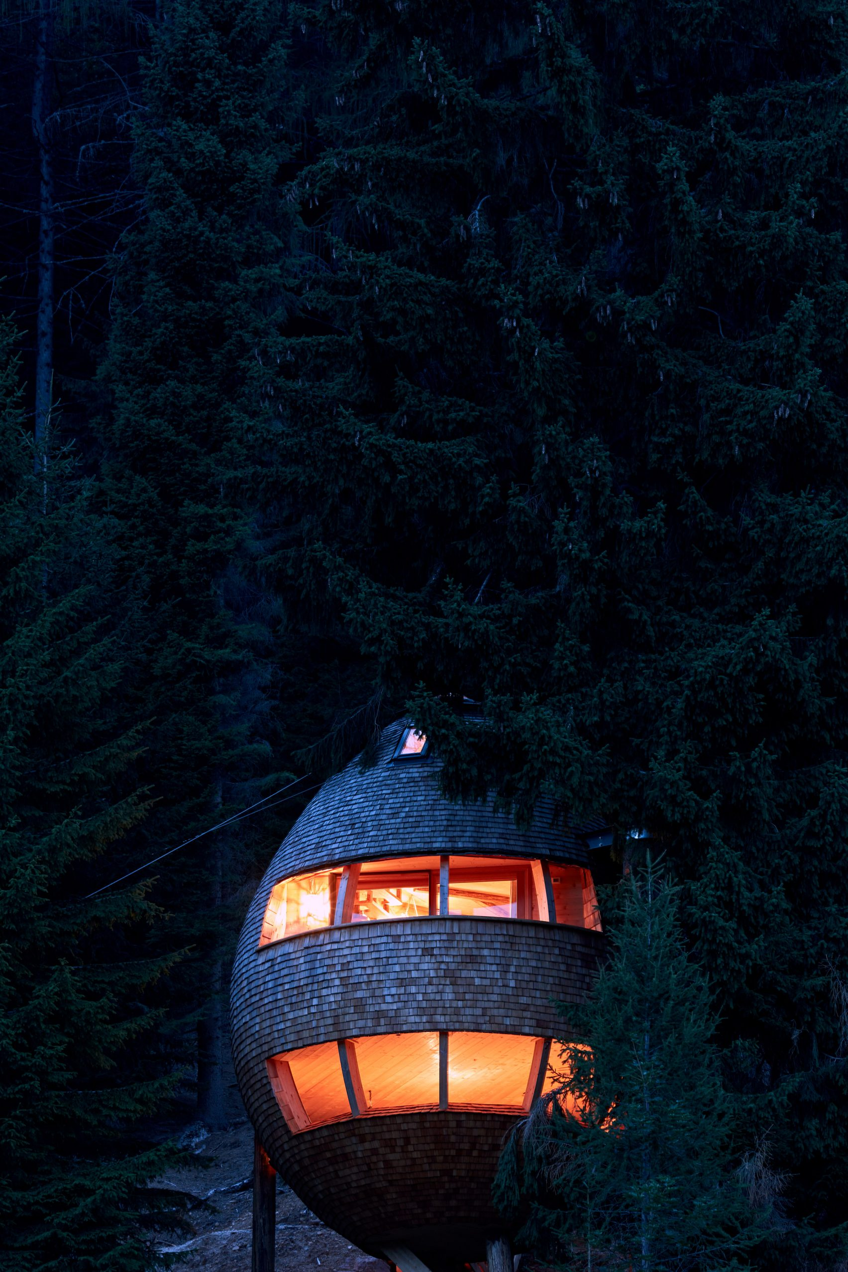 This pine cone-shaped treehouse is simply delightful