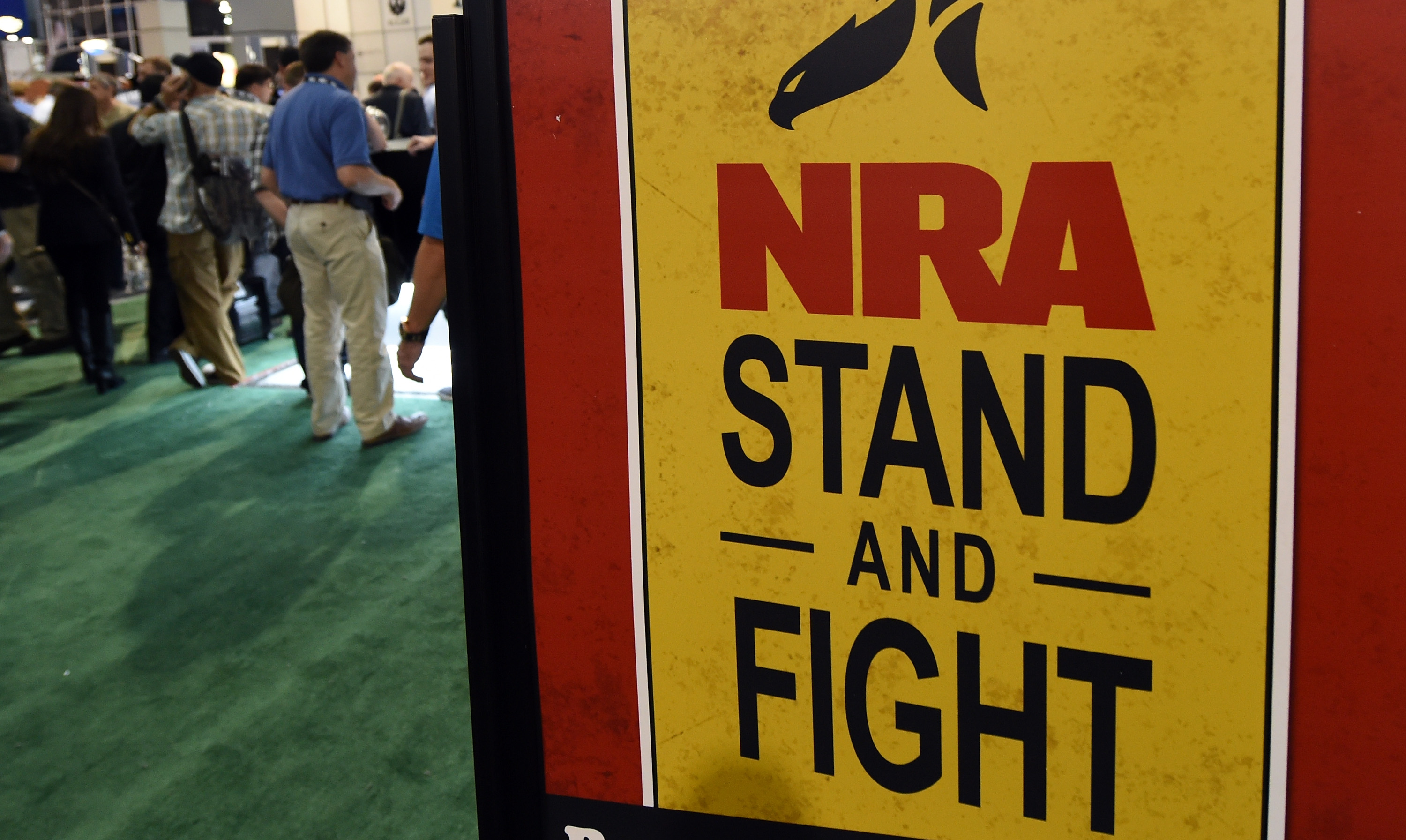 A sign for the NRA at a shooting, hunting, and outdoor convention.