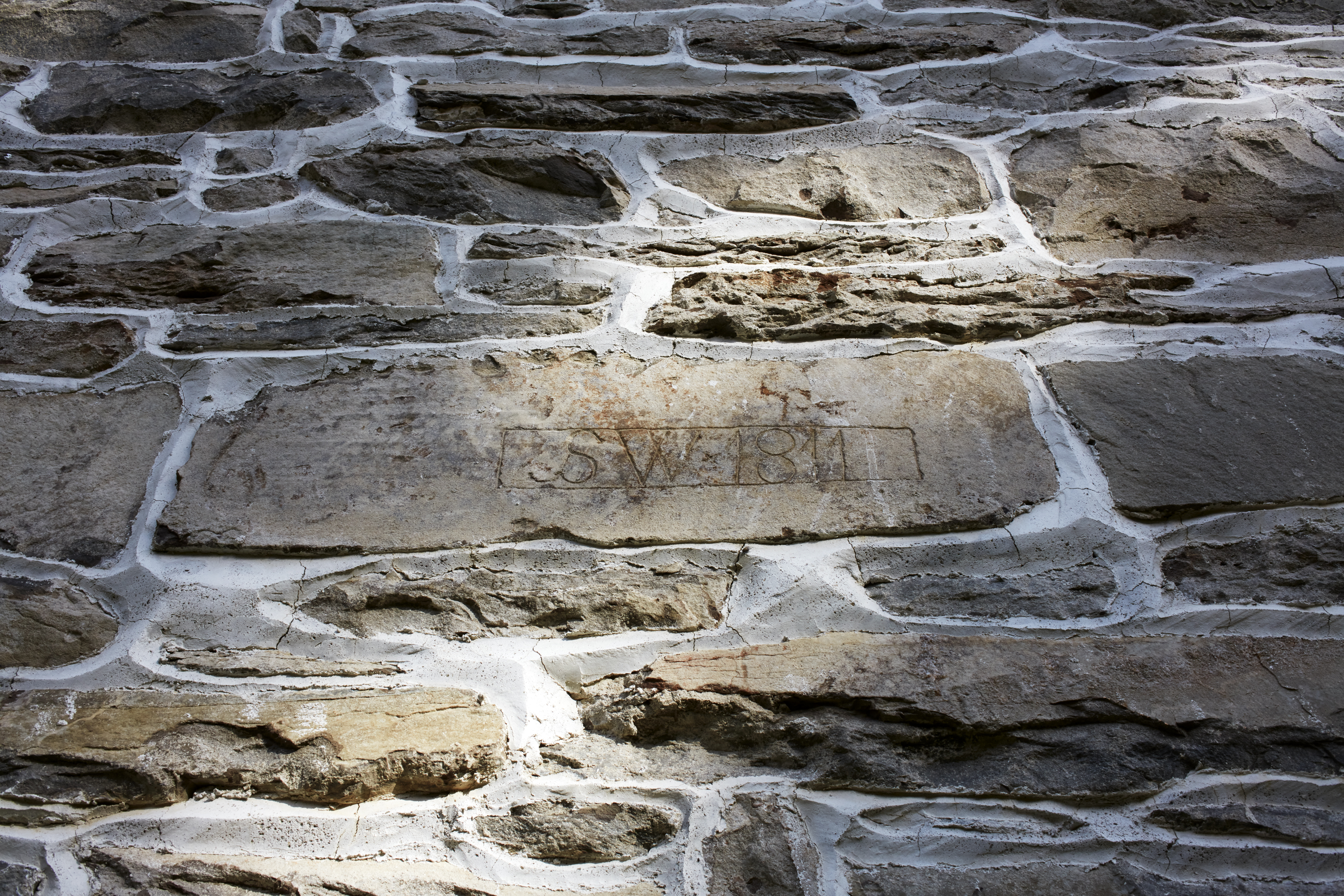 On the stone exterior, you can see SW 1911 carved.