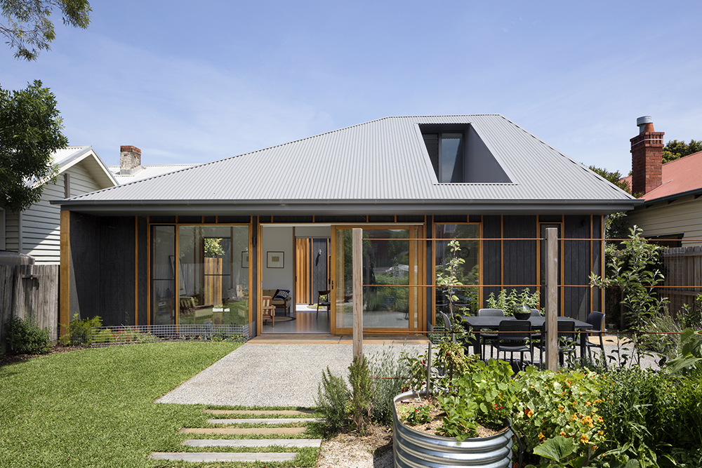 Modern home gets a high end look with low cost materials for Low cost modern homes