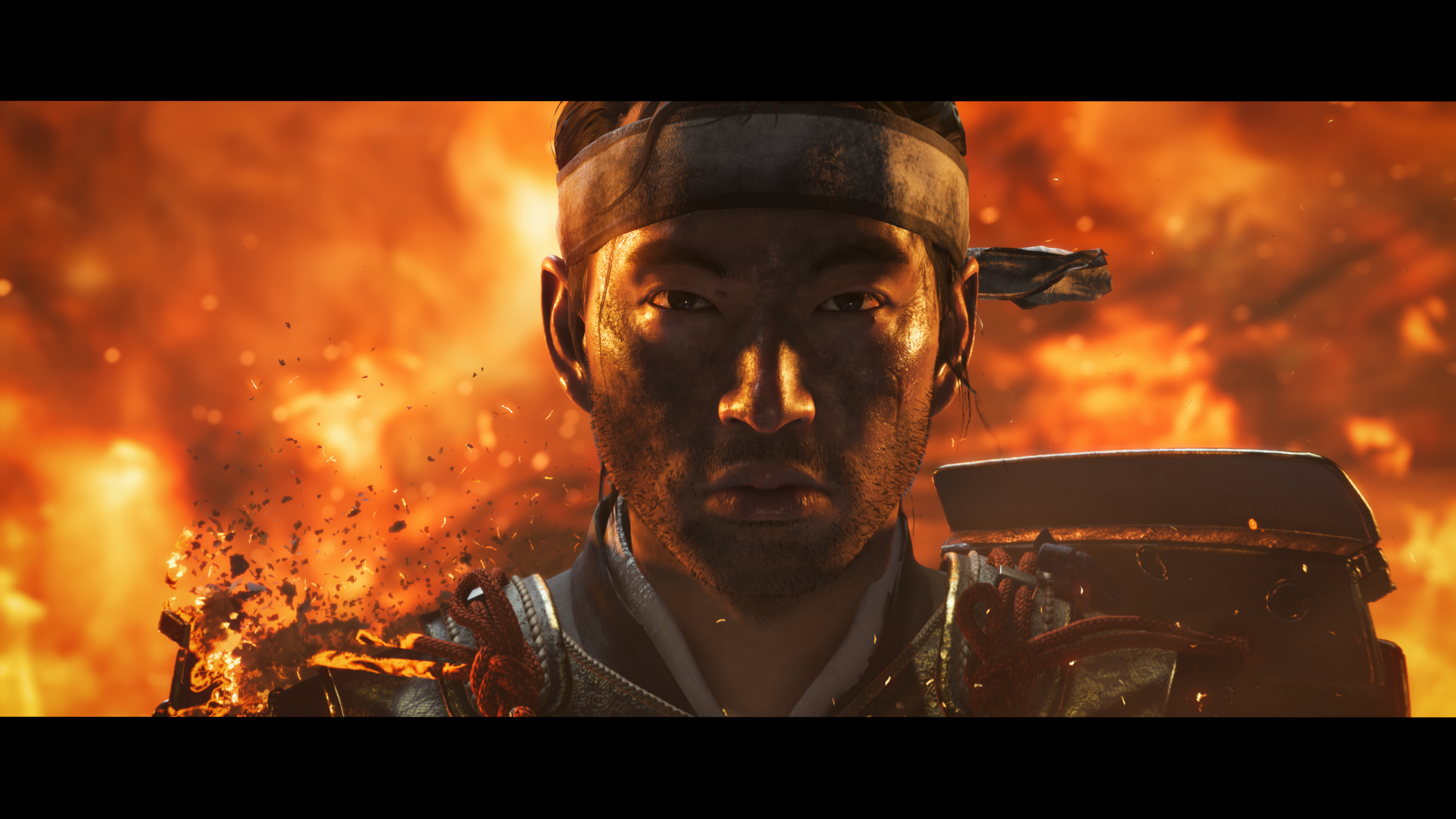 A Japanese village burns behind a lone surviving samurai Sucker Punch Productions Sony Interactive Entertainment