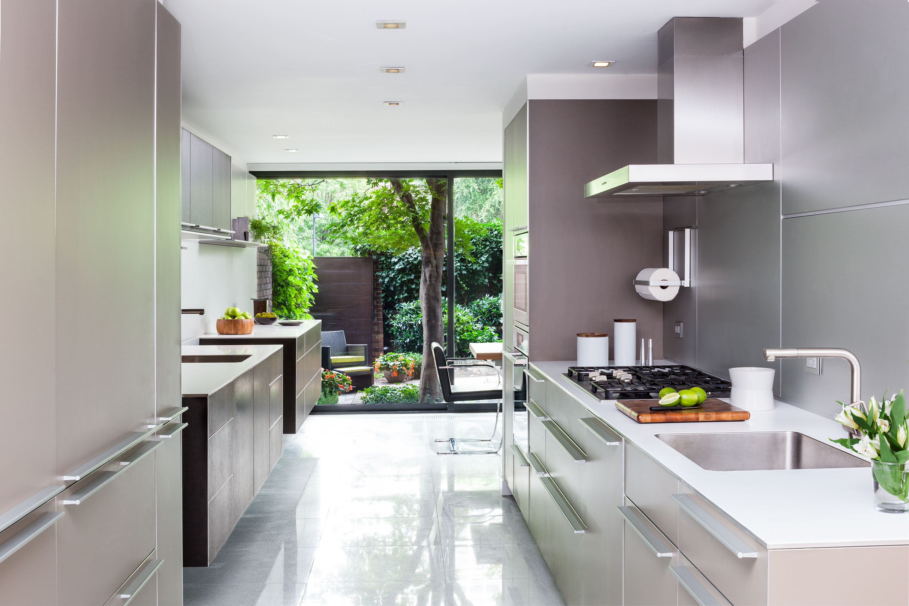 A Kitchen Features Metal Cabinets And Metal Lined Walls.
