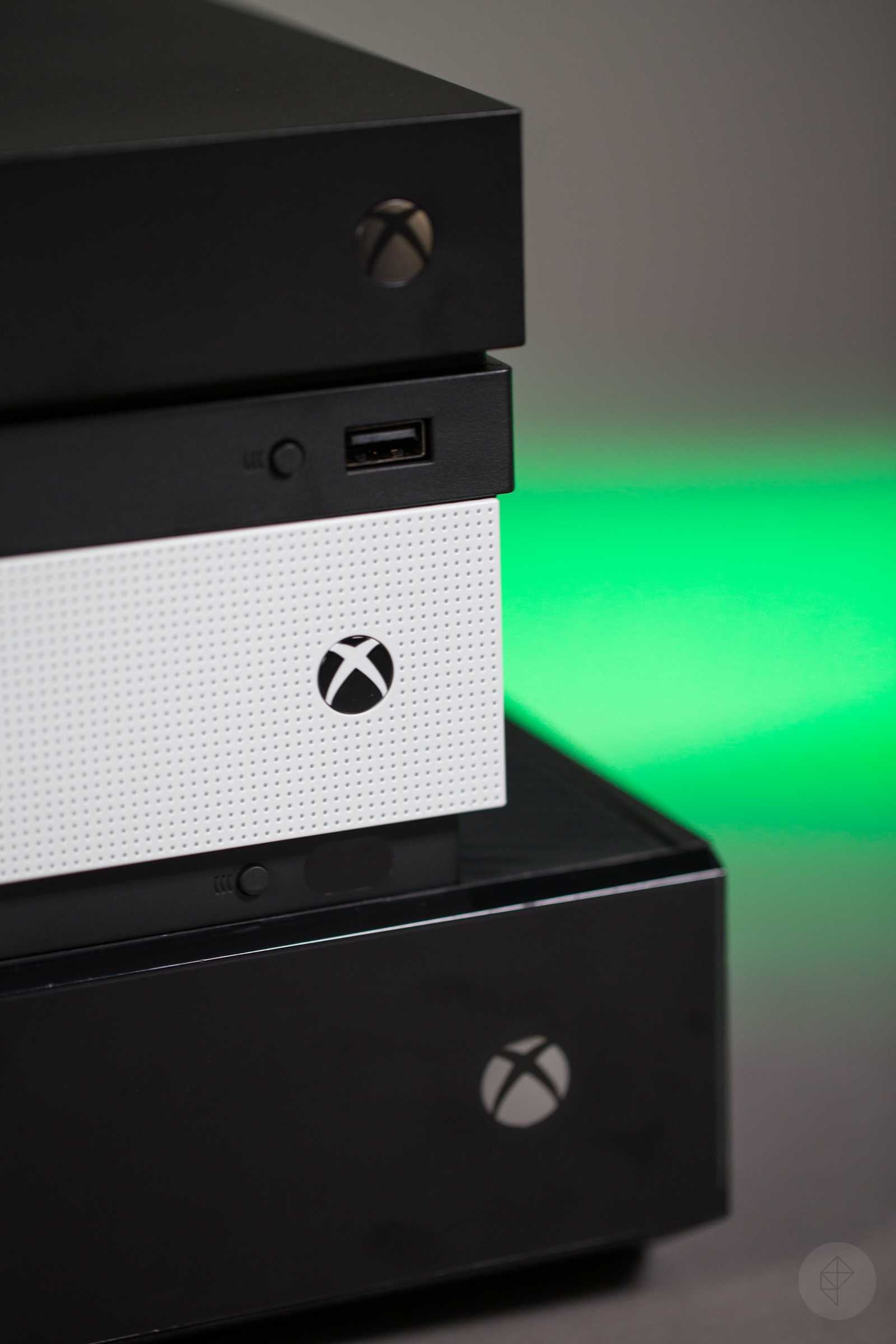 Xbox One X, Xbox One S, Xbox One stack - vertical close-up of right front corner
