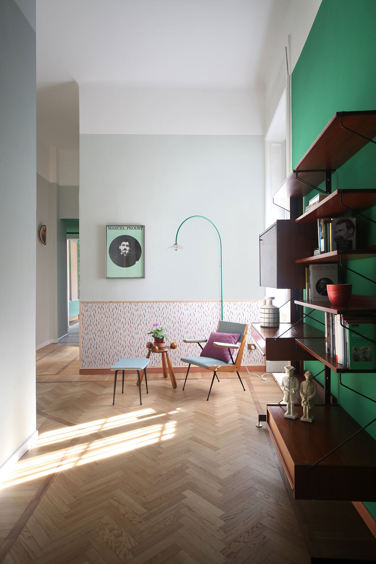 A custom-made green console with Vienna-straw screen ides the lounge from the dining area which flows into a kitchen of light blue black ... & Ravishing colors bring this Milan apartment renovation to life ... azcodes.com