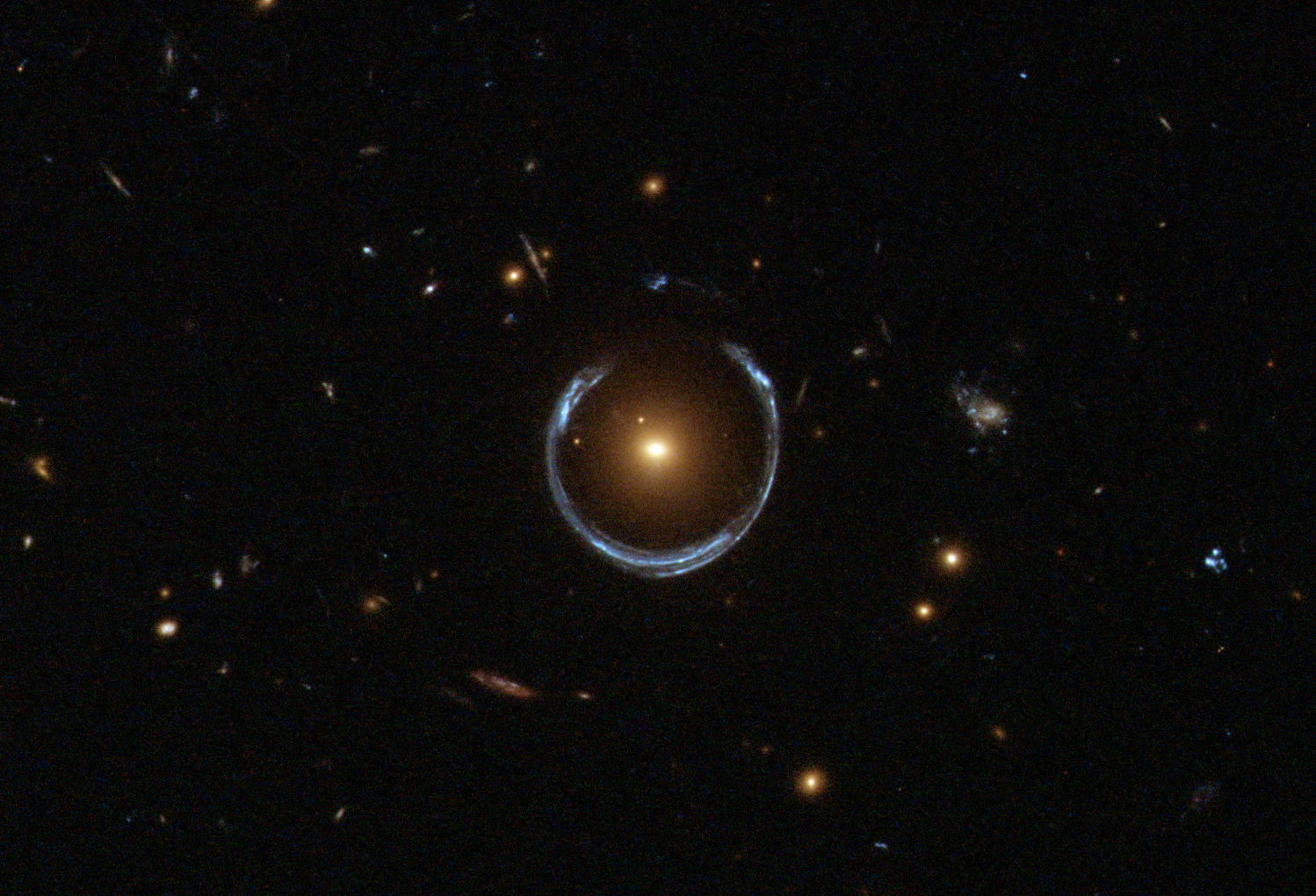 a gravitational lens the nearer red galaxy has bent the light of the more distant blue galaxy around it in a horseshoe shape image nasa apod - Astronomy Jobs At Nasa