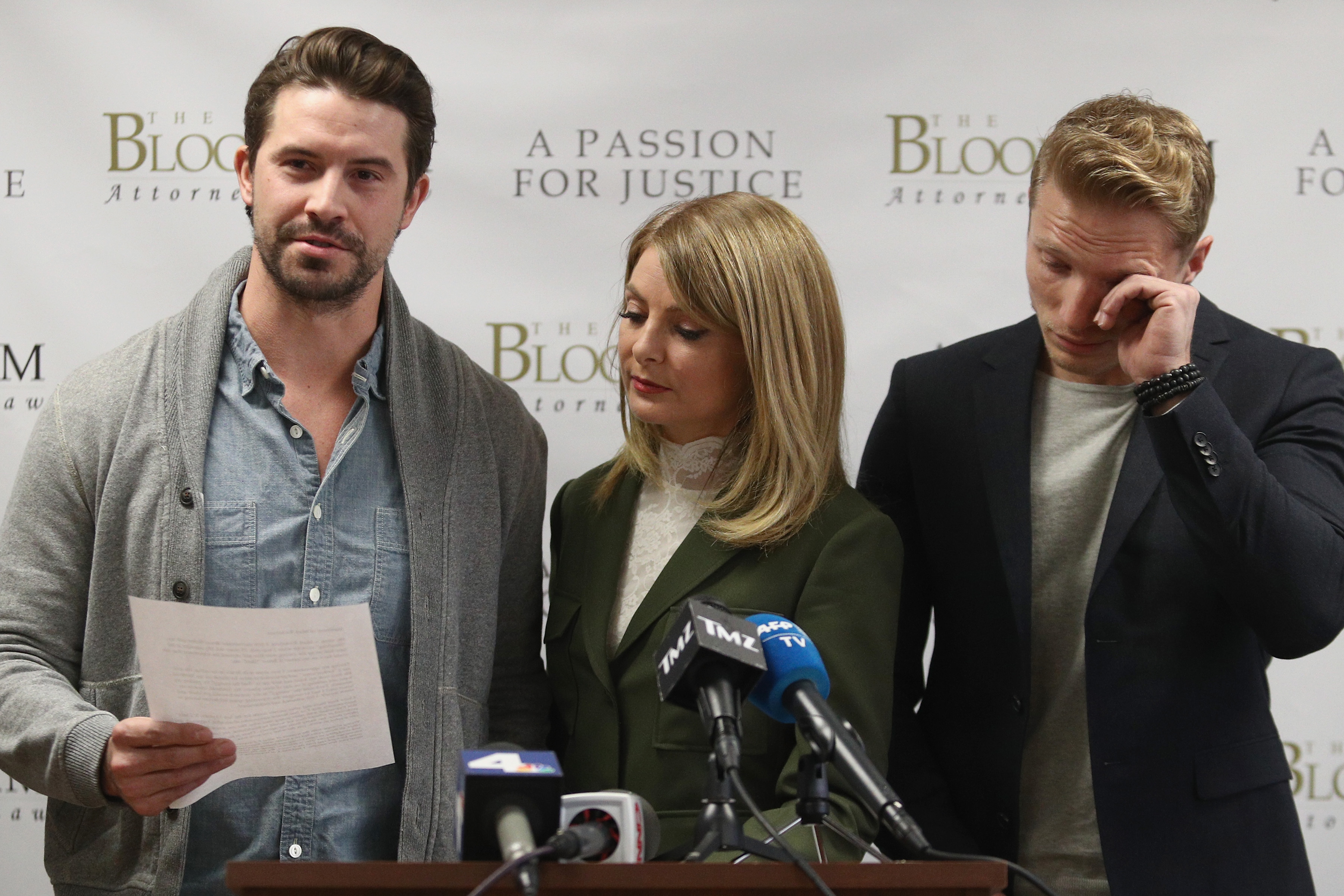 Model Mark Ricketson (l) reads a statement at The Bloom Firm accusing photographer Bruce Weber of sexual misconduct. Attorney Lisa Bloom and former model Jason Boyce stand beside him.