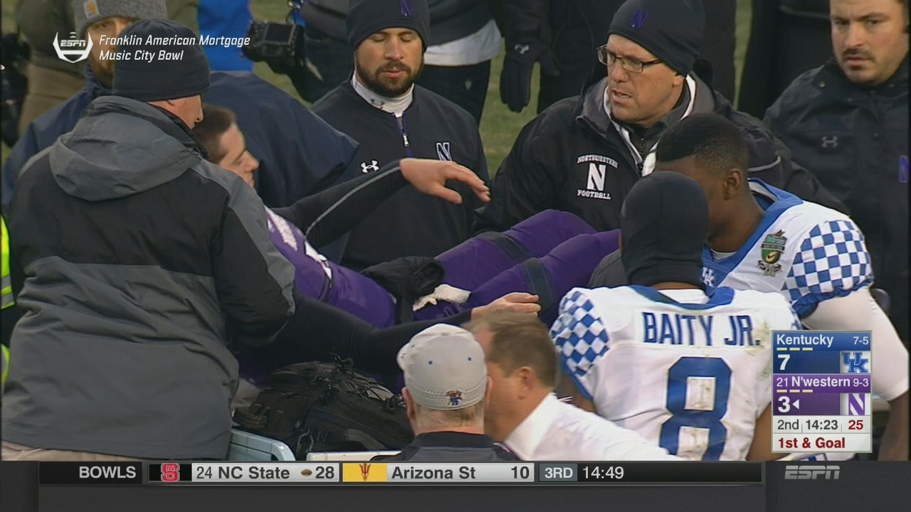 Wild half of ejections and injuries for Northwestern at Music City Bowl