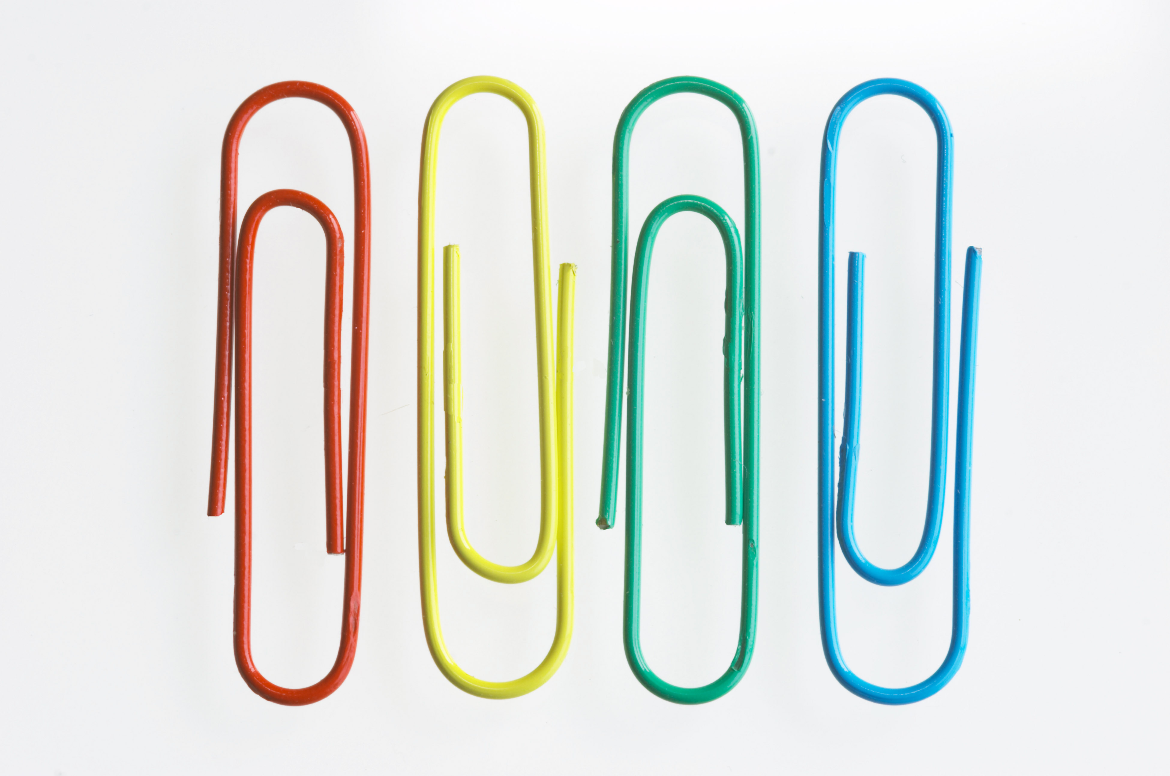four paper clips: red, yellow, green, blue
