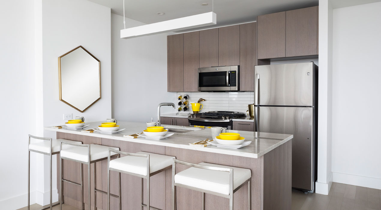 ... Oak Cabinets And Brazilian Stone Countertops In The Kitchen; Walnut  Floors; Soaking Tubs In The Bathrooms; And A Washer U0026 Dryer In Each Unit.