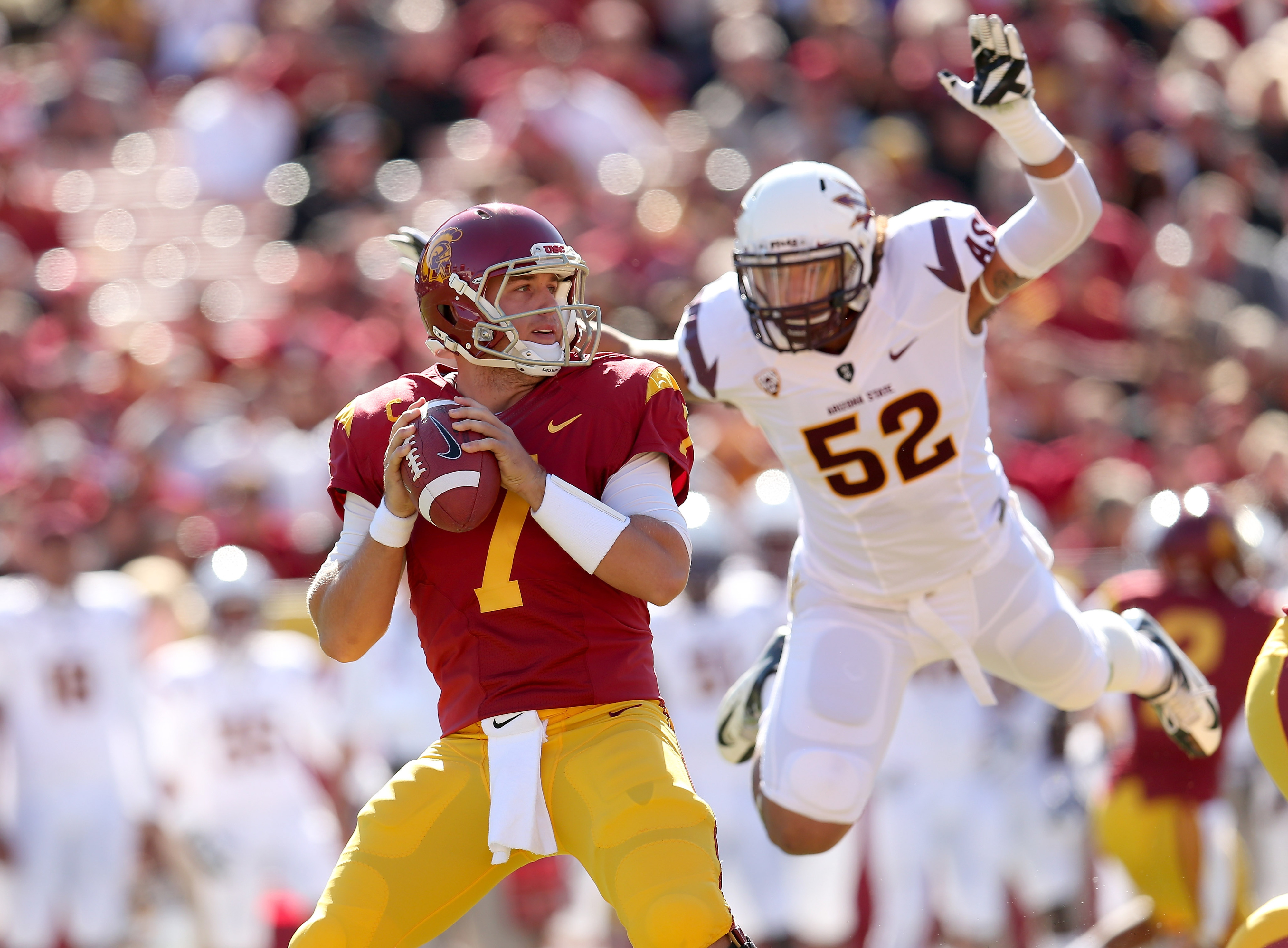 Carl Bradford prepares to smother USC quarterback Matt Barkley.