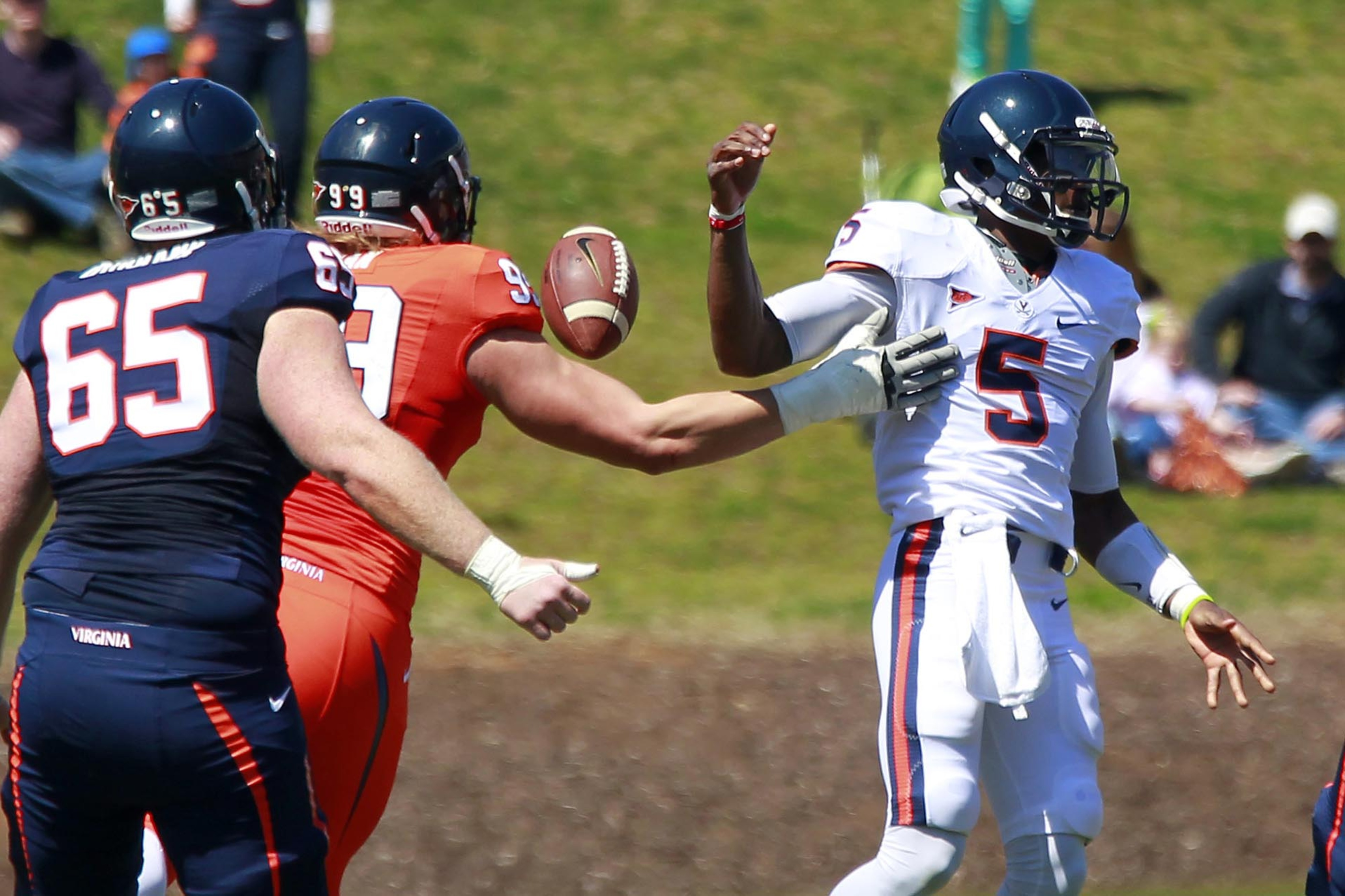 QB David Watford struggles to hold on to the ball in Saturday's spring game.