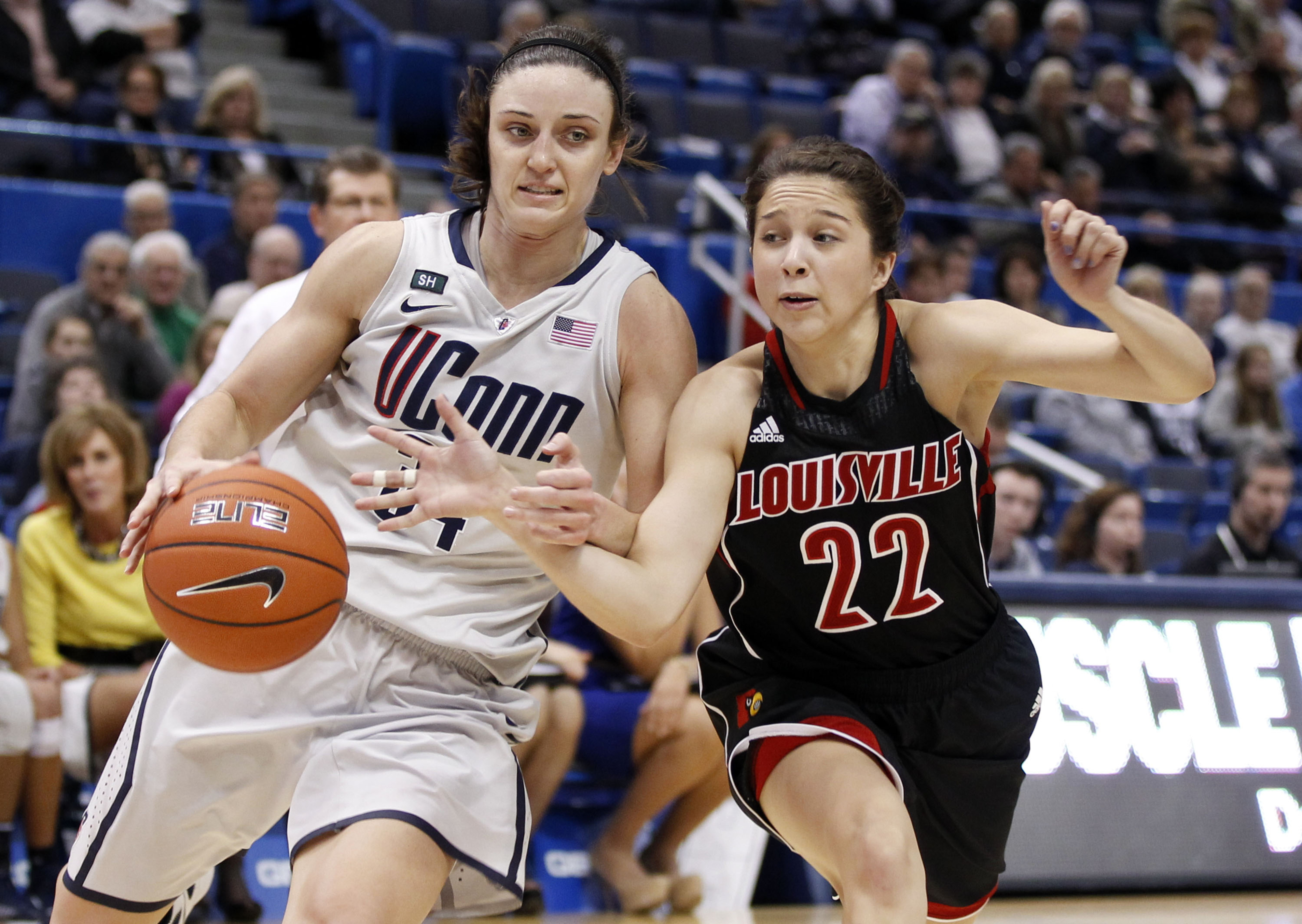 UConn Guard Kelly Faris drives to the basket with Louisville Guard Jude Schimmel defending her in a January regular season game.  Expect more of the same tonight in the national championship.