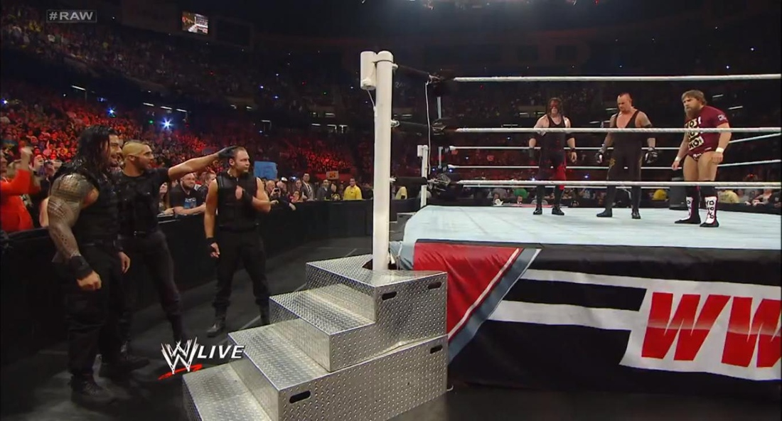 The Shield (Roman Reigns, Seth Rollins & Dean Ambrose face off with Kane, Undertaker & Daniel Bryan on Monday Night Raw before making a hasty retreat into the stands (Apr.8)