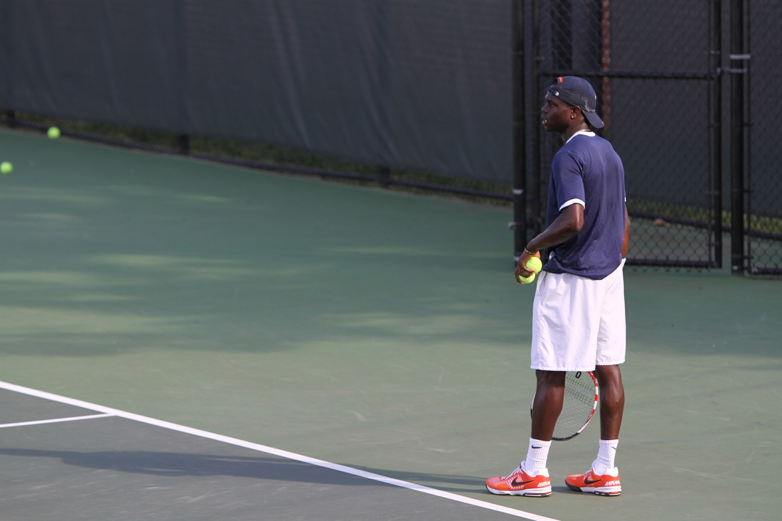 Jarmere Jenkins prepares to server during Virginia's 100th consecutive ACC victory