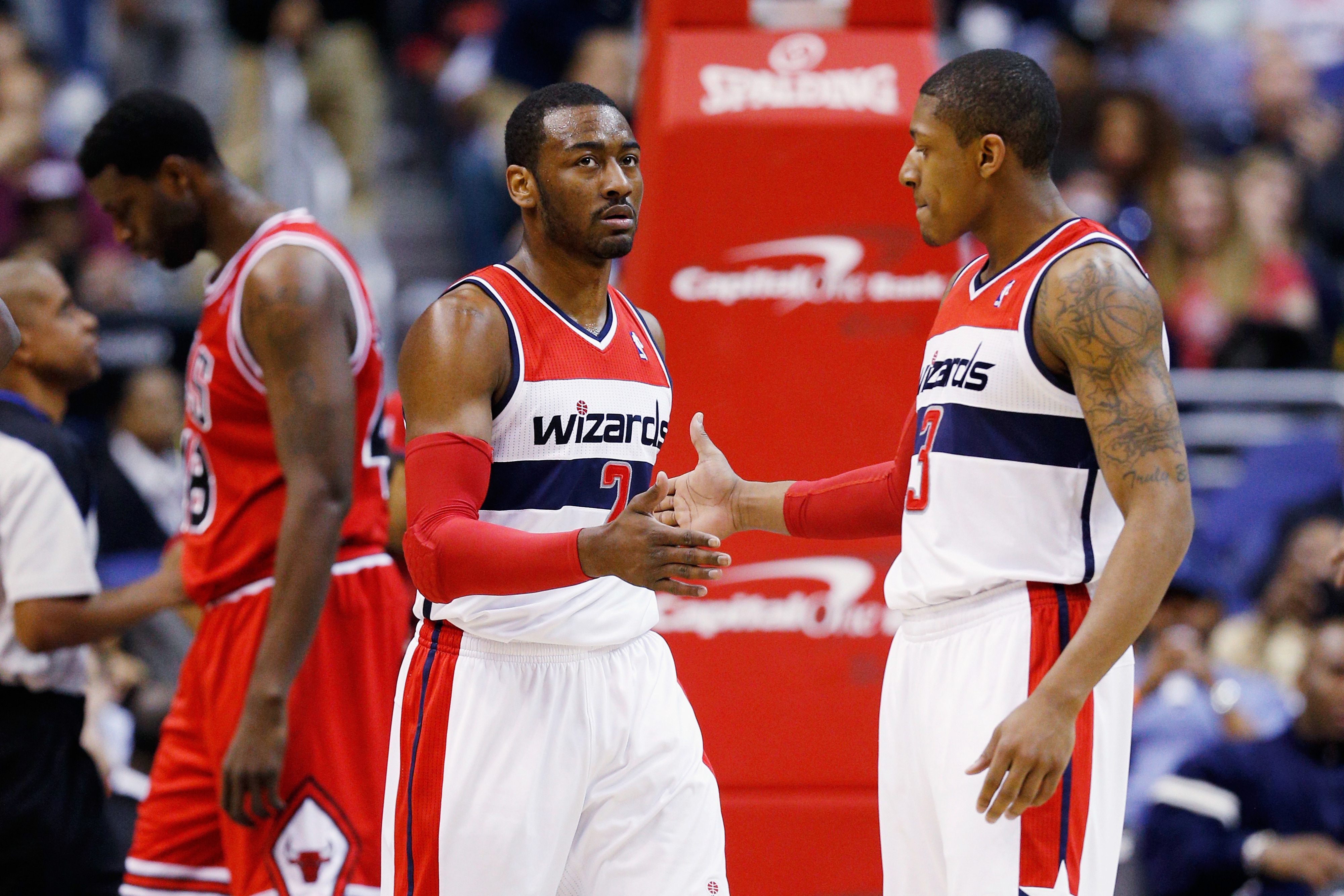 John Wall and Bradley Beal (left and right) are two Wizards first round picks who are developing well and figure to be in DC for a long time.  The Mystics need to do the same starting with Tayler Hill (not pictured).