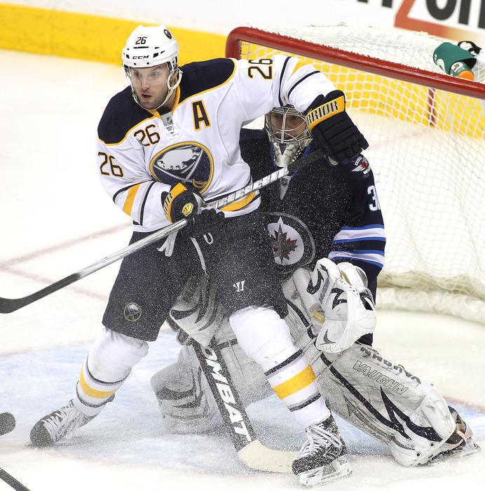 Buffalo Sabres forward Thomas Vanek (#26 white) screens Winnipeg Jets goaltender Ondrej Pavelec.