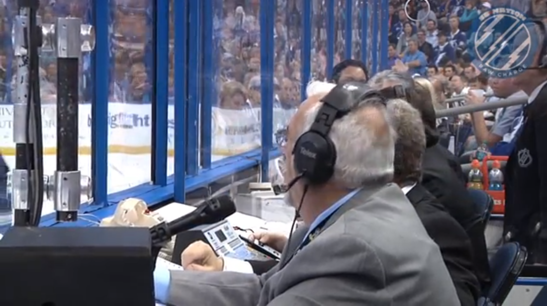 The dedicated crew at the Tampa Bay Times Forum works at the rink-side scorekeepers desk during the Lightning's contest with the Pittsburgh Penguins on April 11, 2013.