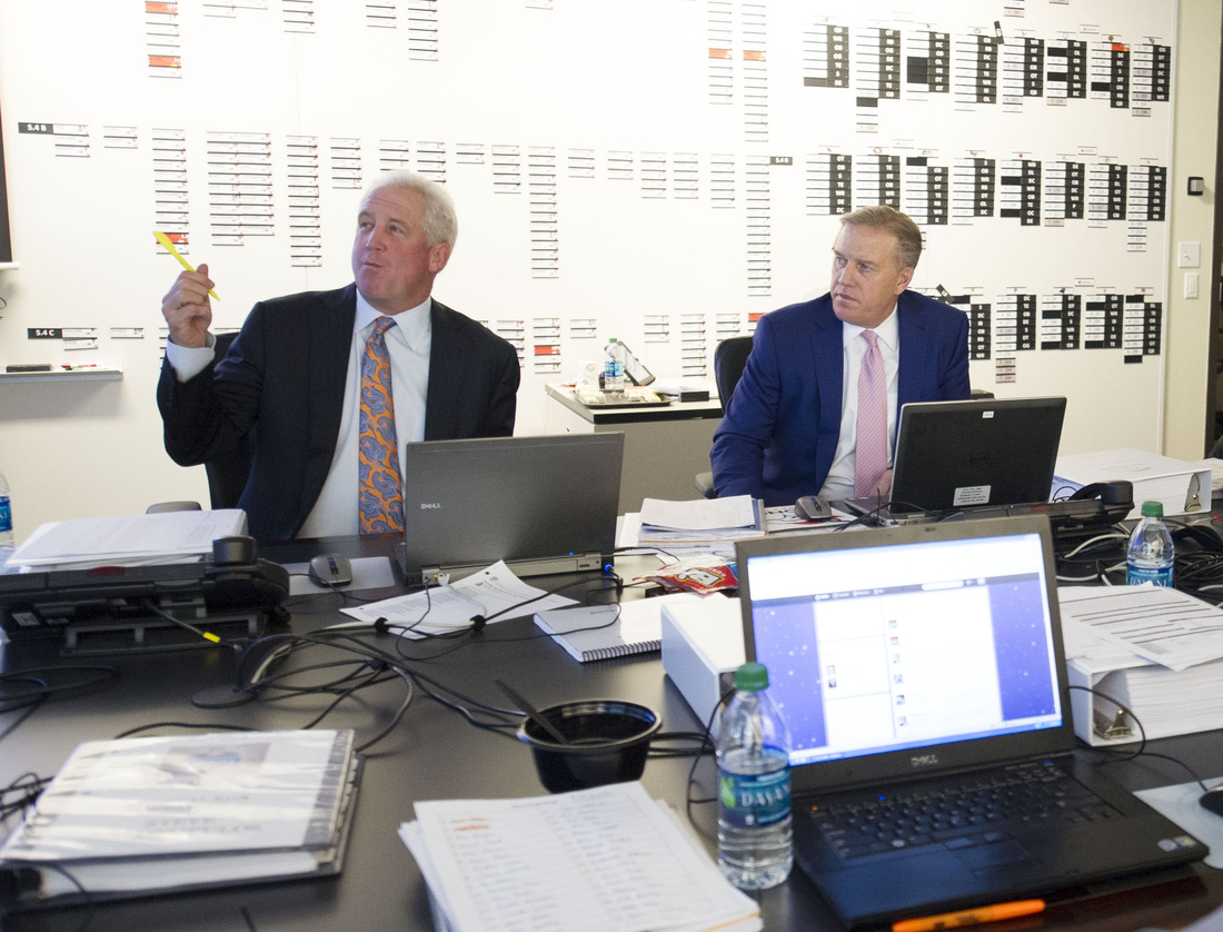 John Fox and John Elway in the Broncos war room during the 2013 NFL Draft.