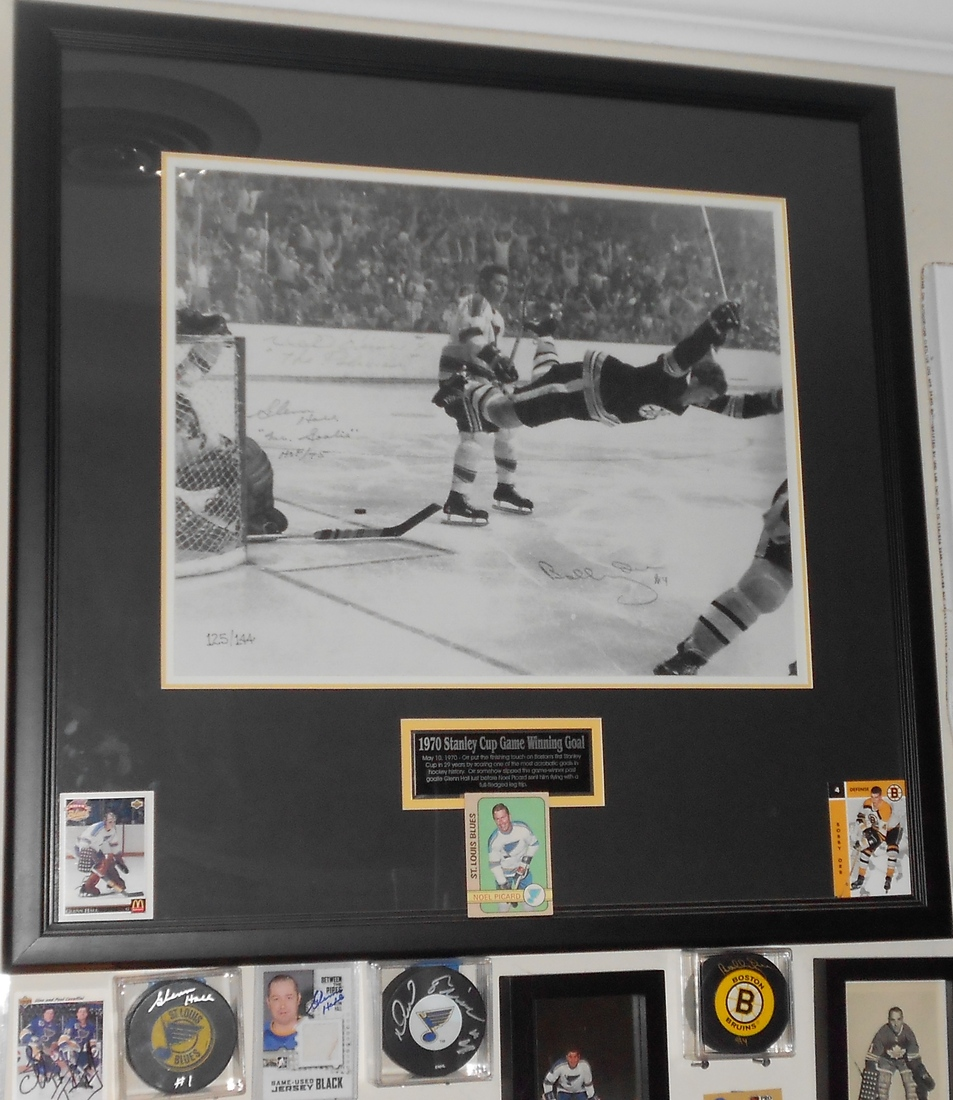 memorabilia: Bobby Orr's 1970 Stanley Cup winning goal signed by Orr, Glenn Hall and Noel Picard Hockey cards of each and signed pucks from each