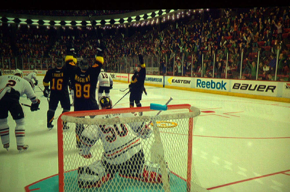 Linden, Mogilny and Naslund celebrate the game-winning goal against the Hawks in Game 5